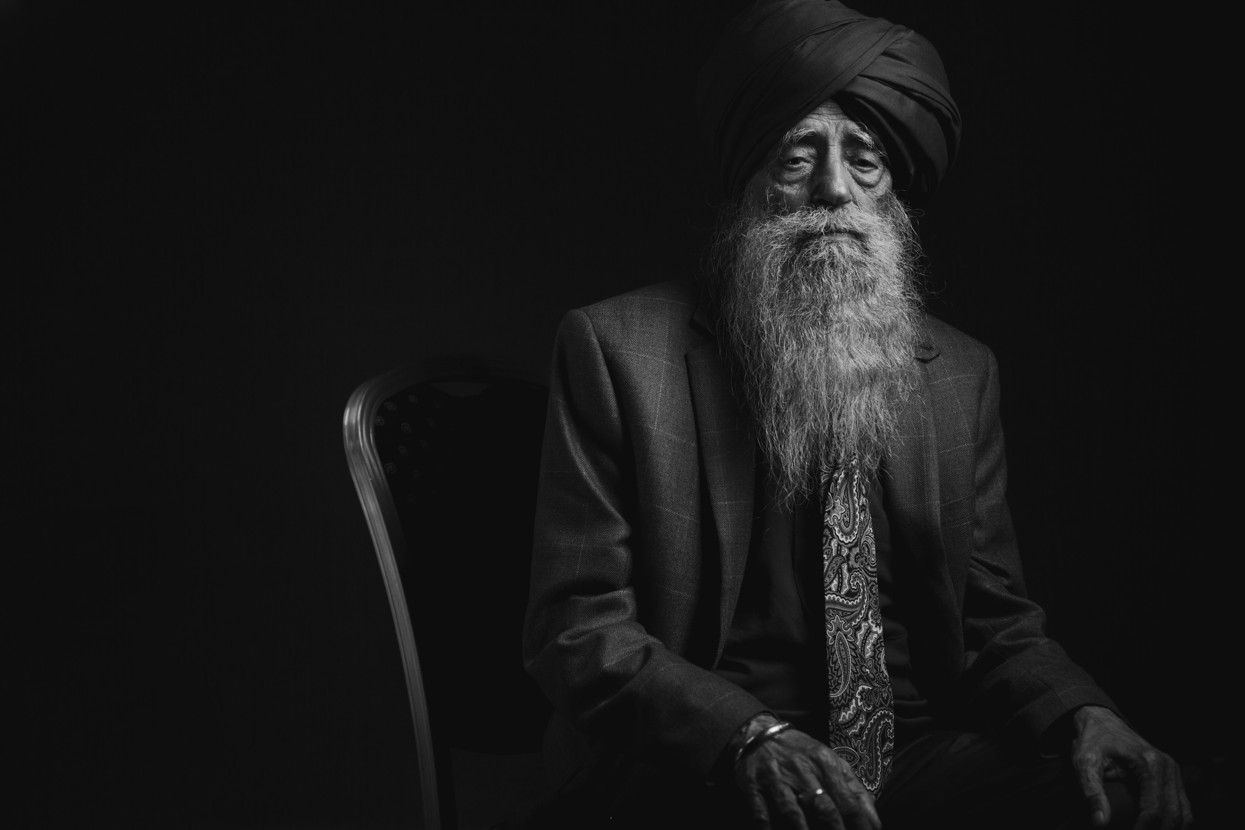 Fauja Singh Portrait sitting black & white
