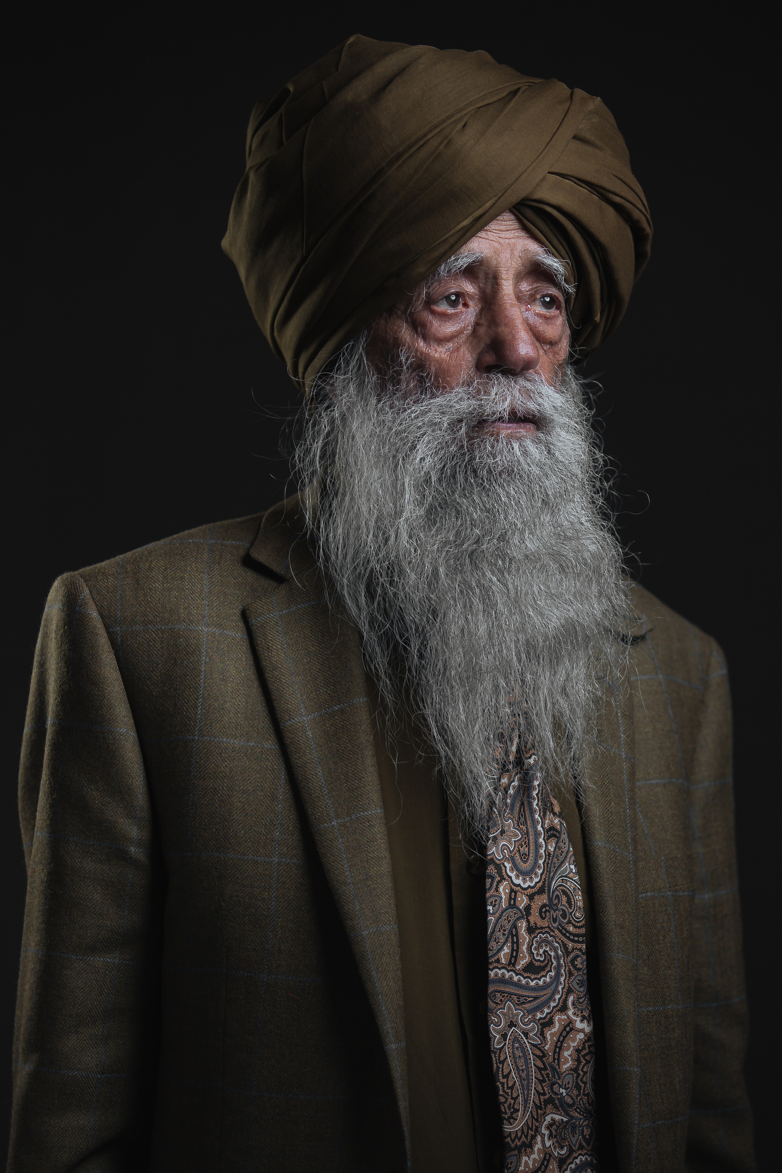 Fauja Singh Portrait standing looking at light