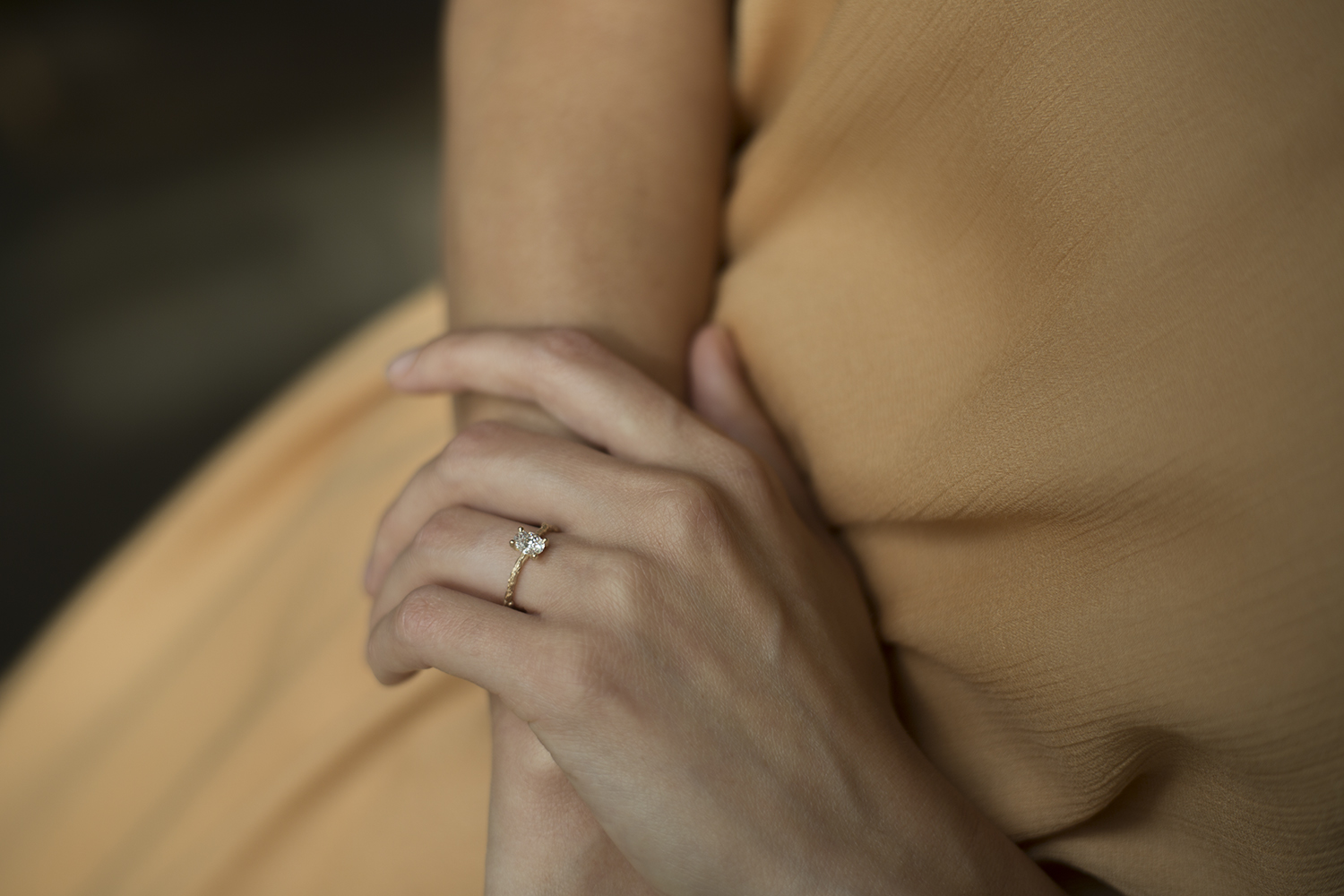 woman wearing hand carved engagement ring