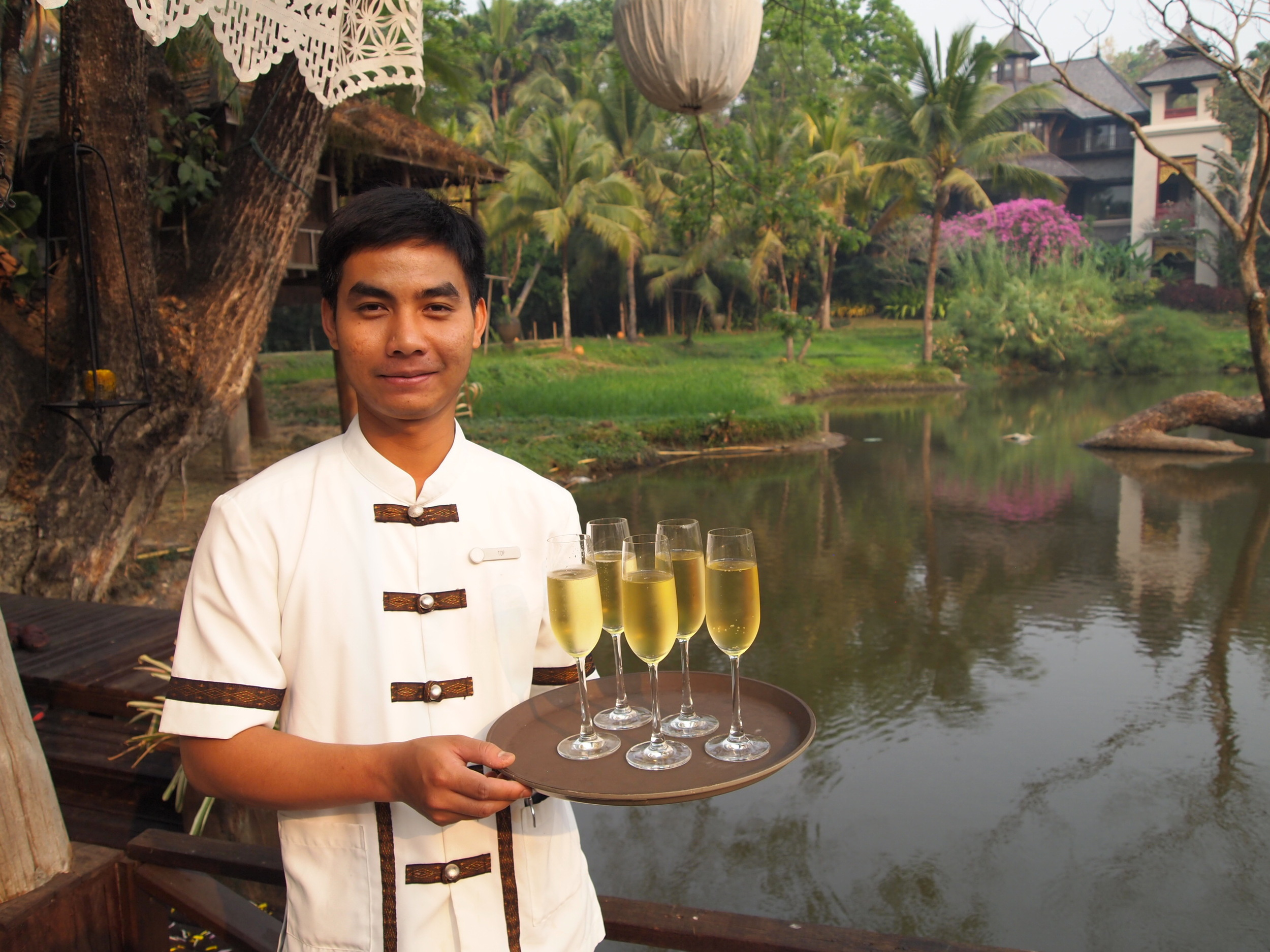 A server offering Monsoon Valley, Thailand's only locally made, beautifully flavored sparkling wine