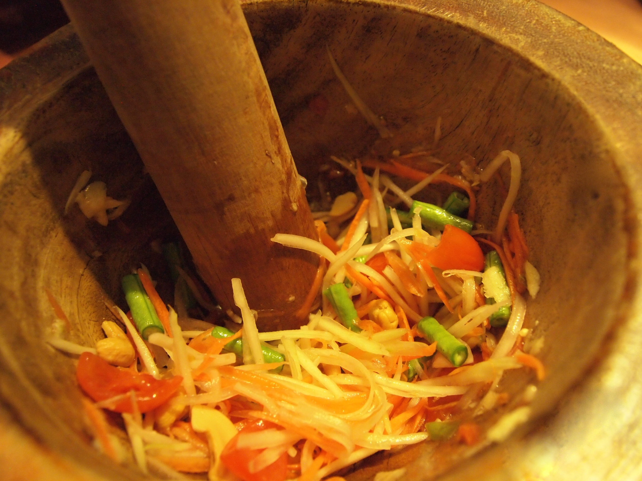 Mixing my own green papaya salad in cooking class