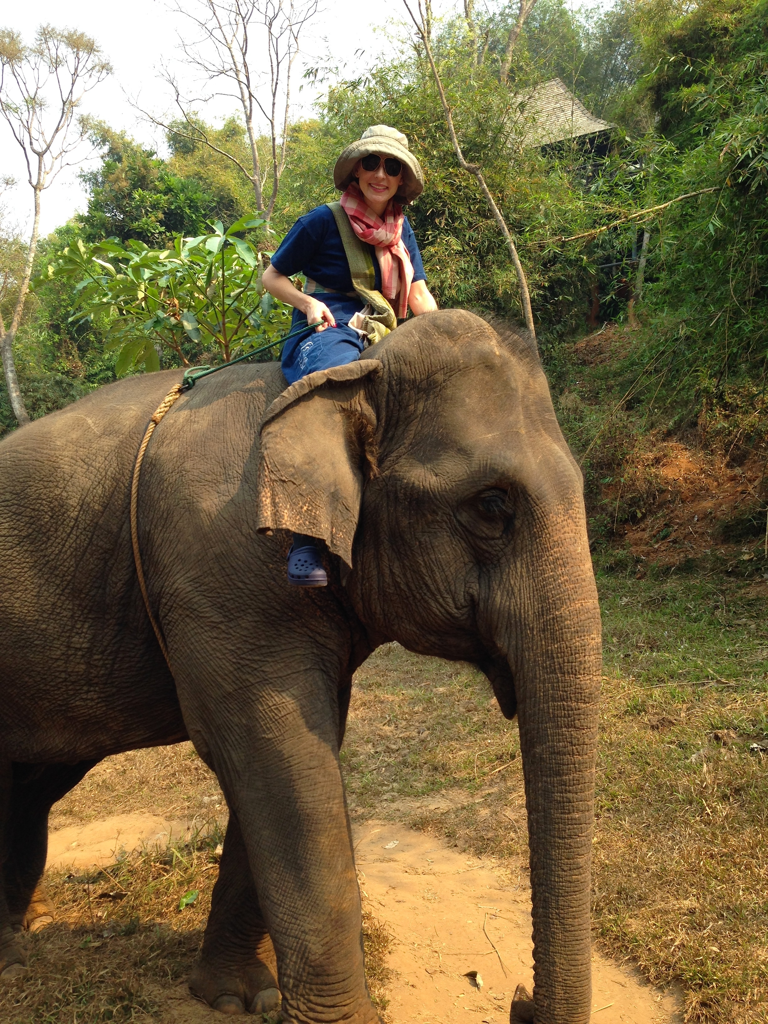 Learning elephant-riding commands. Note the amazing denim getup: Traditional crop pants, a short-sleeve button-up shirt and a waist sash. If you spot Crocs on my feet, you're not mistaken. Each guest is given a pair to use while trekking. This is one of the ONLY instances wearing crocs is remotely acceptable in my trip stylin' lookbook.