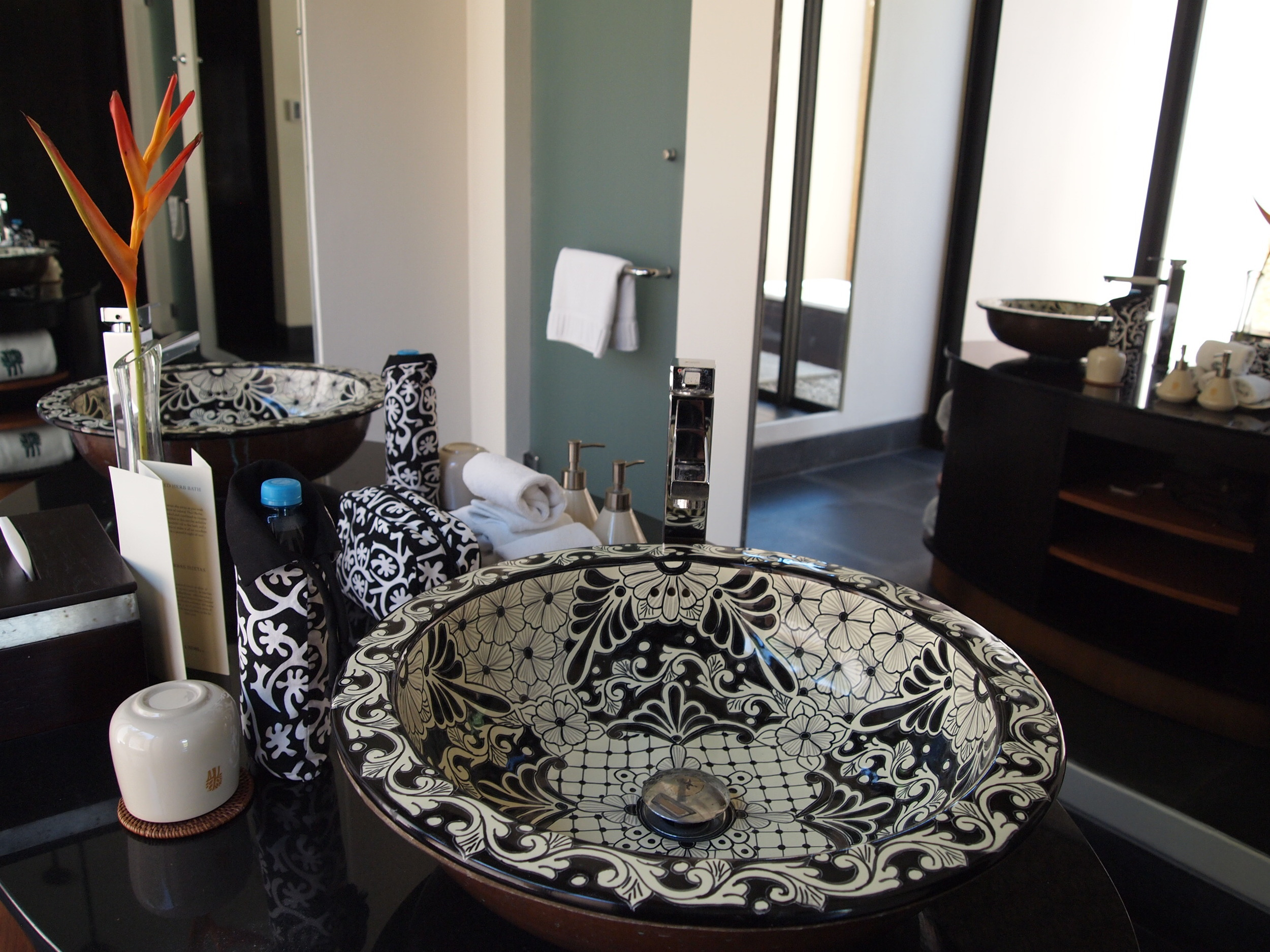 The apartment-sized bathroom with Mexi-gorgeous earthenware sinks