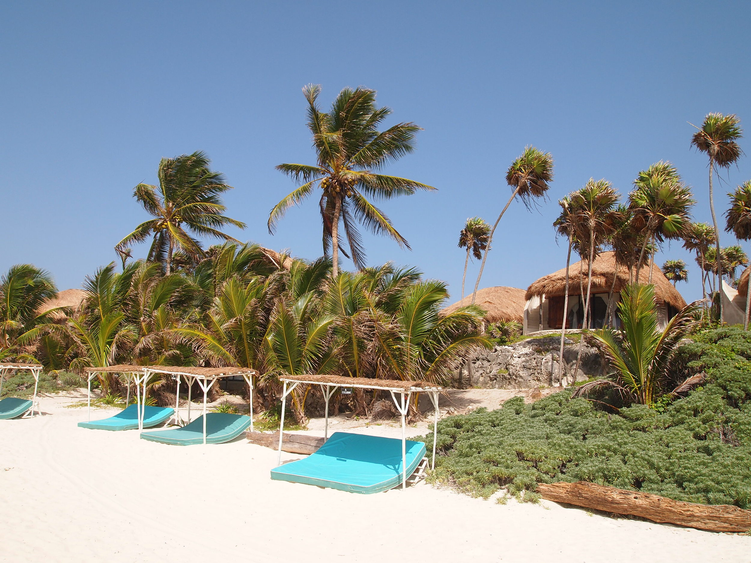 The 900m beach with its handmade beach palapas