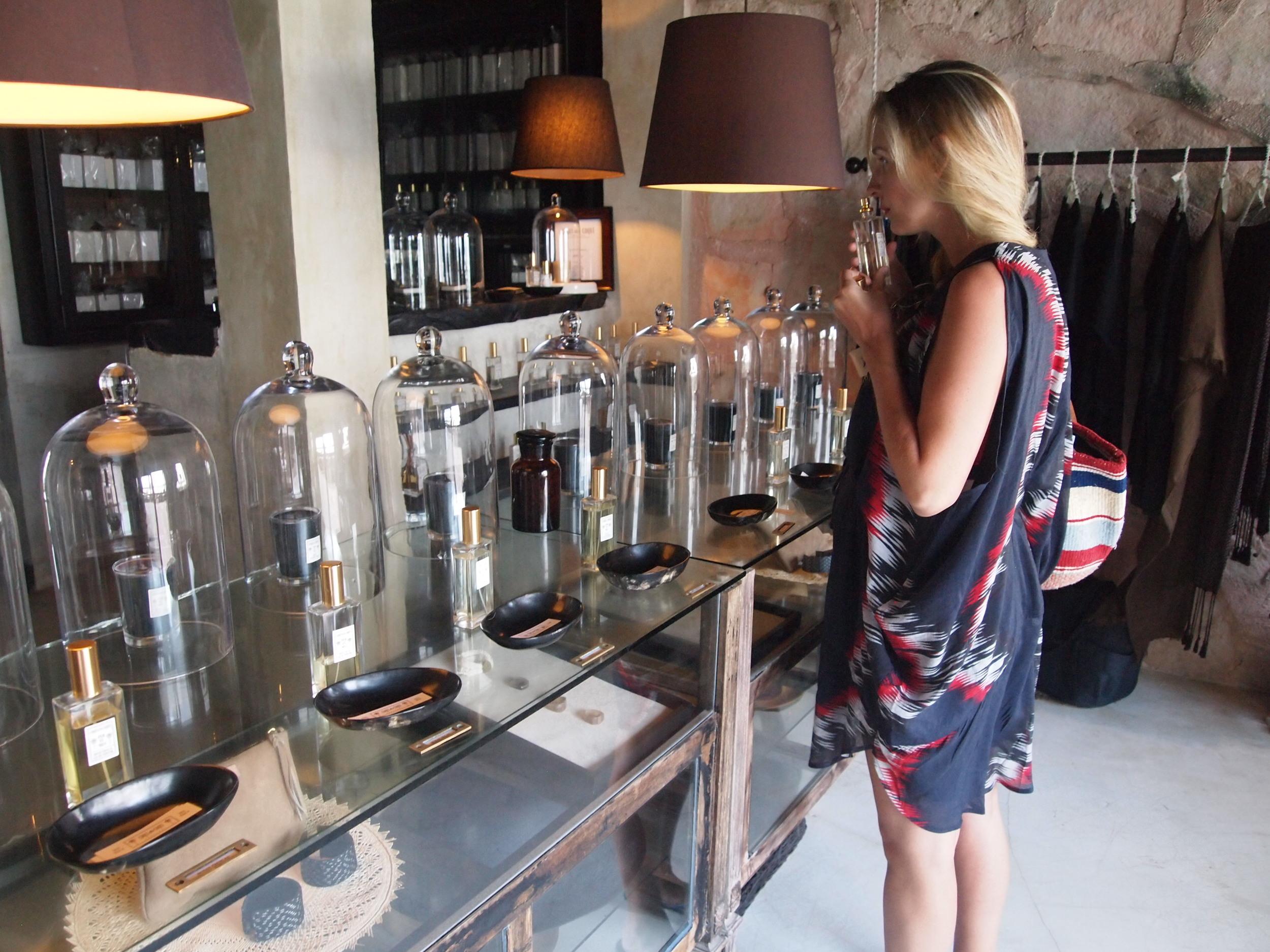 Shopping — make that buying perfume — at Coqui Coqui