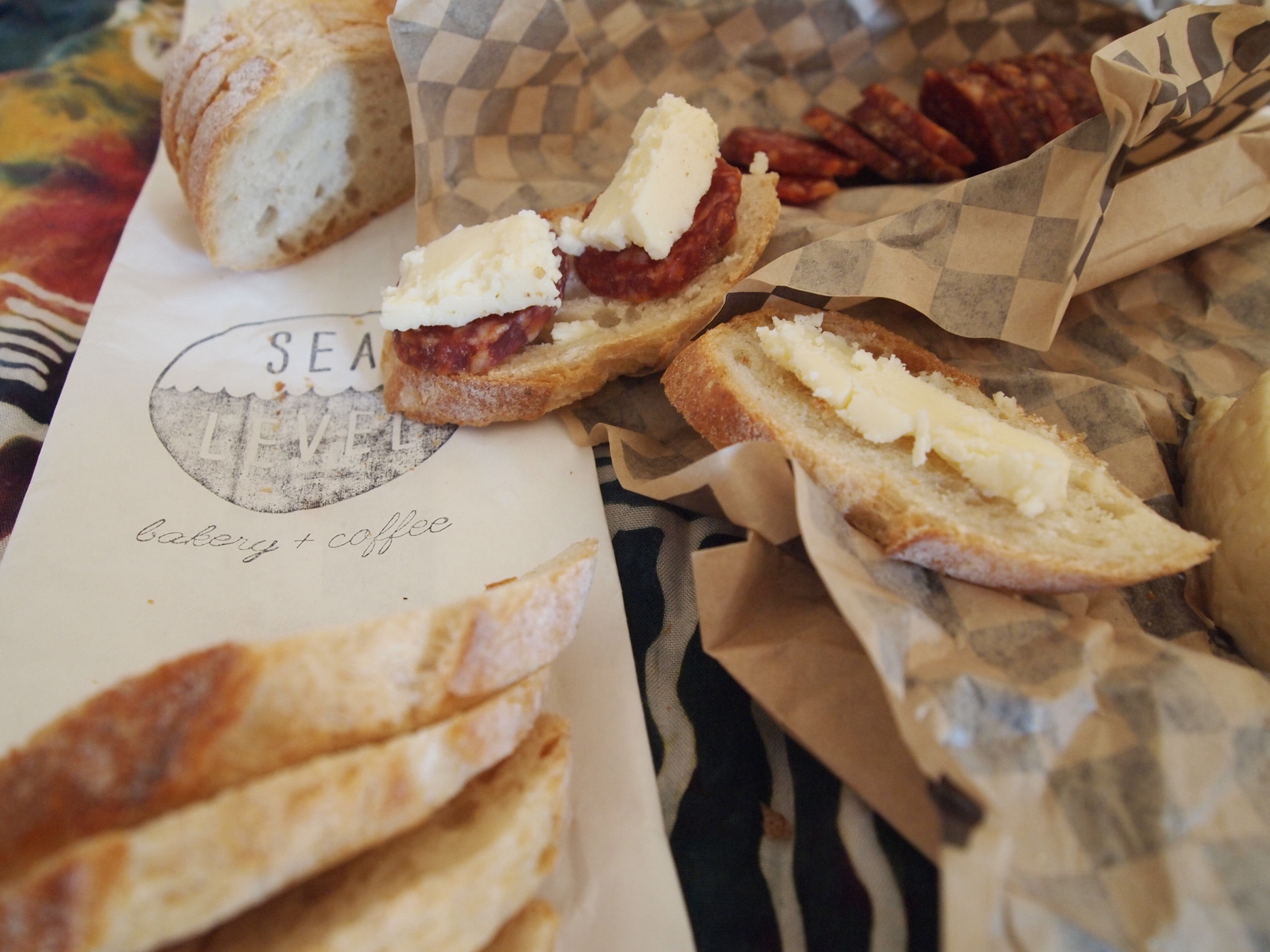 Picnic from EVOO Cannon Beach's take-away shop featuring local cheese and meats, plus bread from Sea Level Bakery.