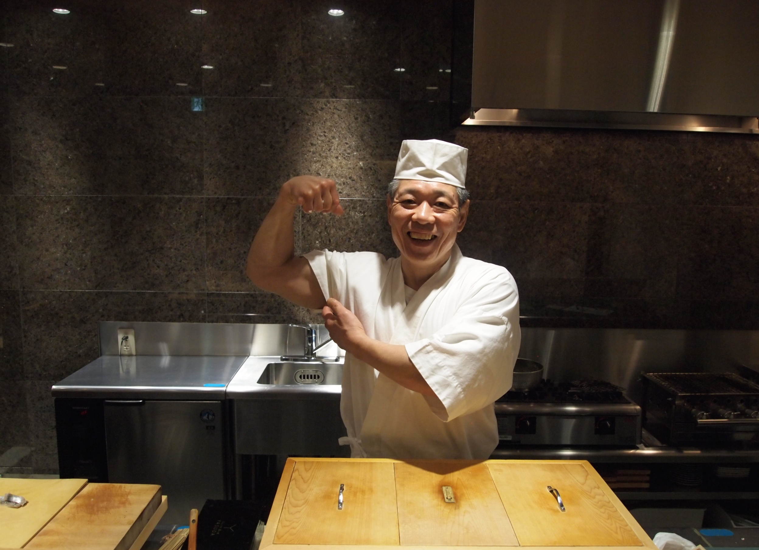 Tokyo. Sitting at the  eight-seat sushi bar  manned by Chef Yasuda, one of the world's most famous sushi chefs.