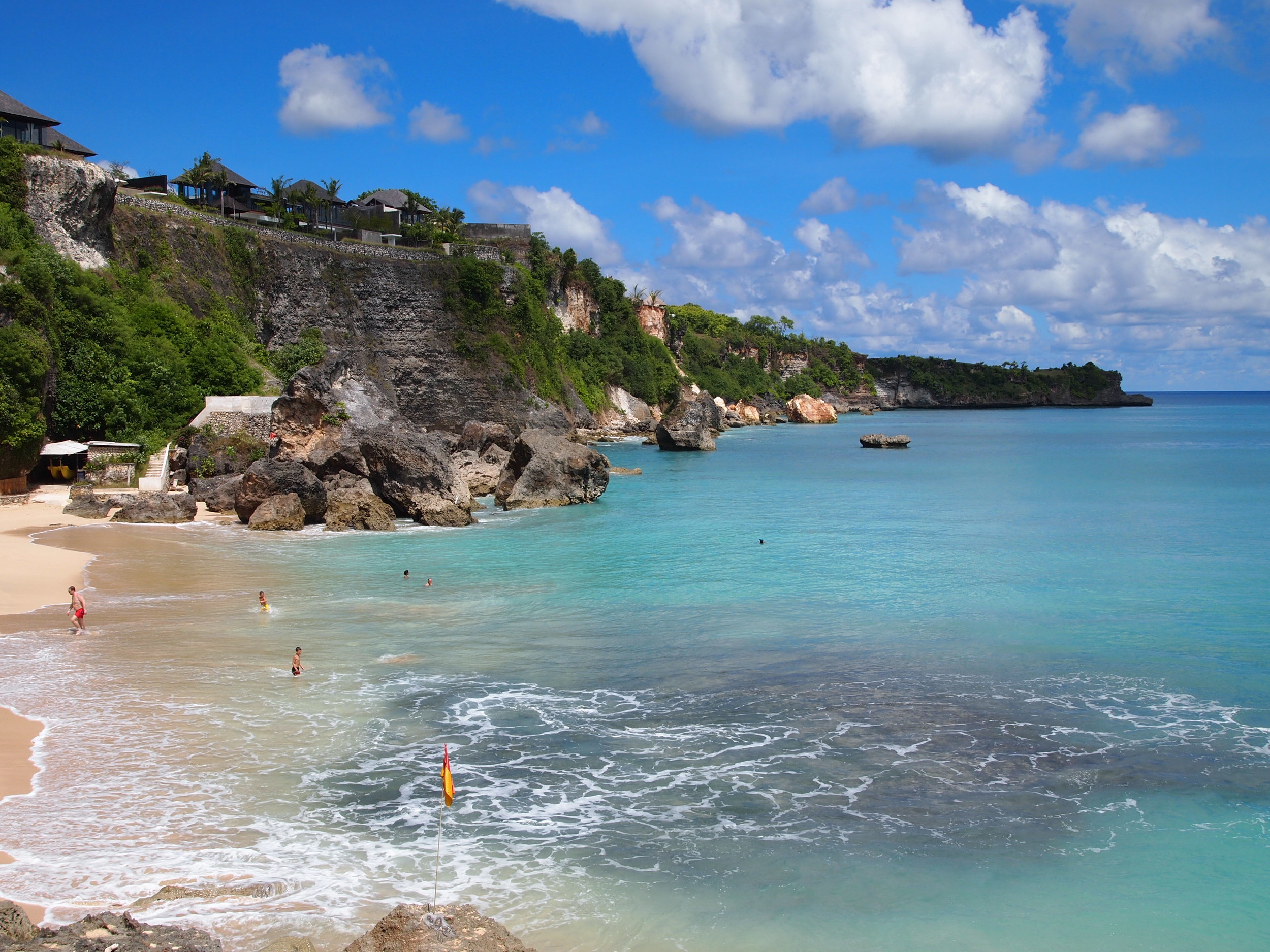 Bali's famous cliffs and, nestled amongst them, theprivate beach for  RIMBA  andAYANA Resorts.