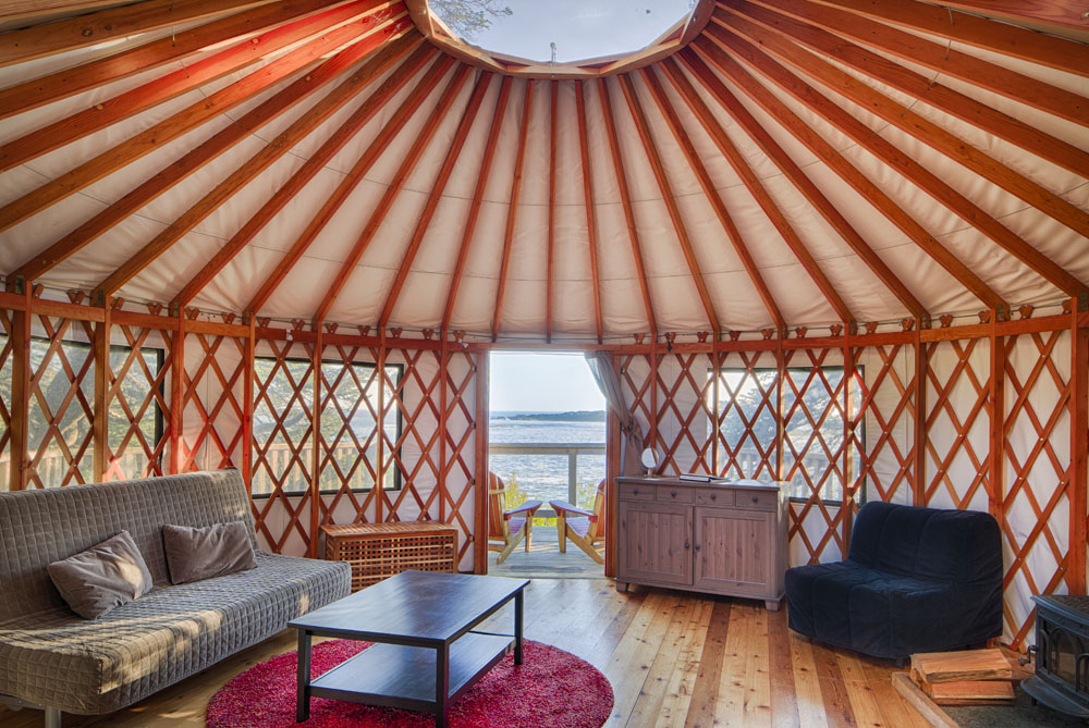 Inside the yurts, which feature a summer kitchen, a wood-burning stove for year-round heat, a dome skylight, and windows oriented toward the ocean for optimal wave-watching and privacy