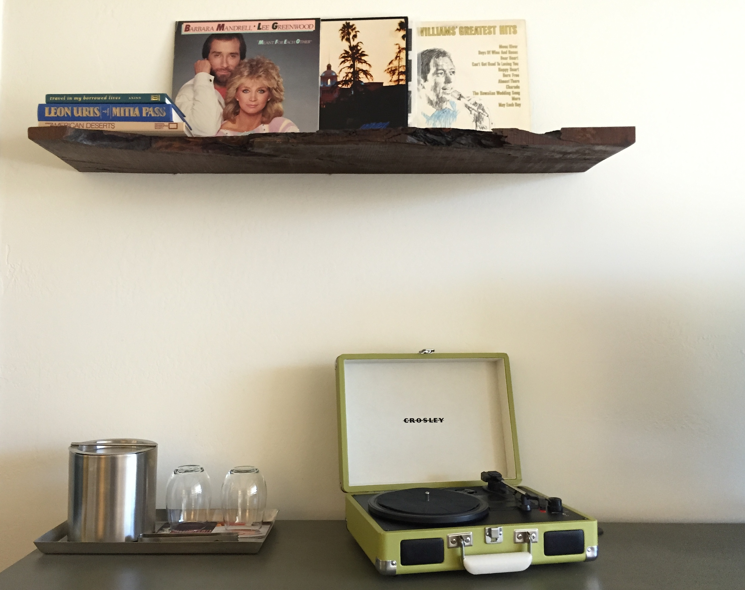 Crosley record players in every room. Want more vinyl? Ask the record concierge to curate a new mix.
