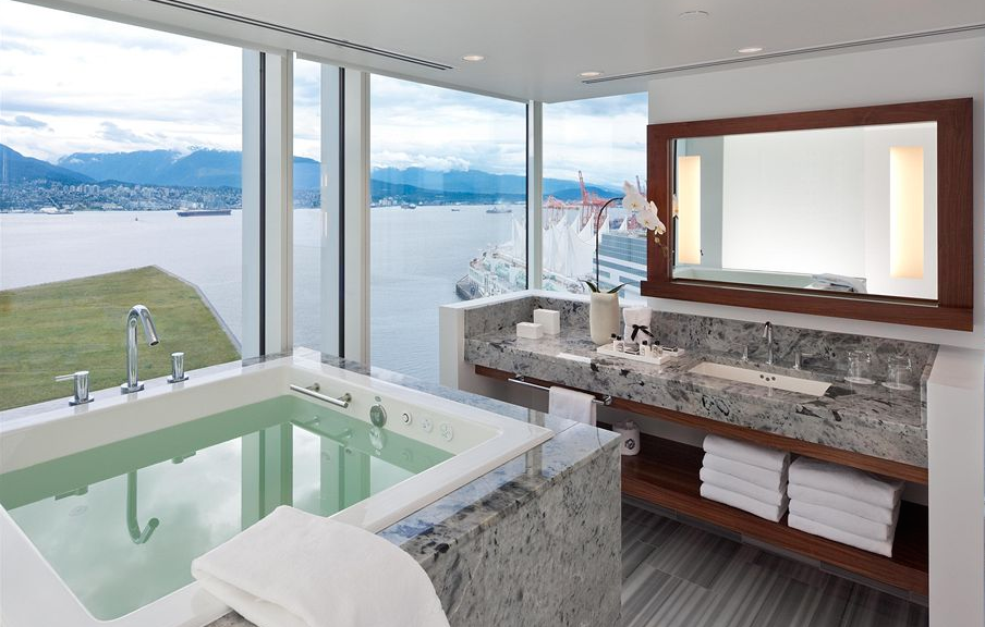 Ourspa-likebathroom the size of city apartment, featuringa waist-deep Ofuro {Japanese soaking tub} perched overCanada Place.