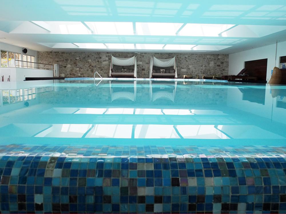 Indoor infinity seawater pool with adjacent rooftop terrace