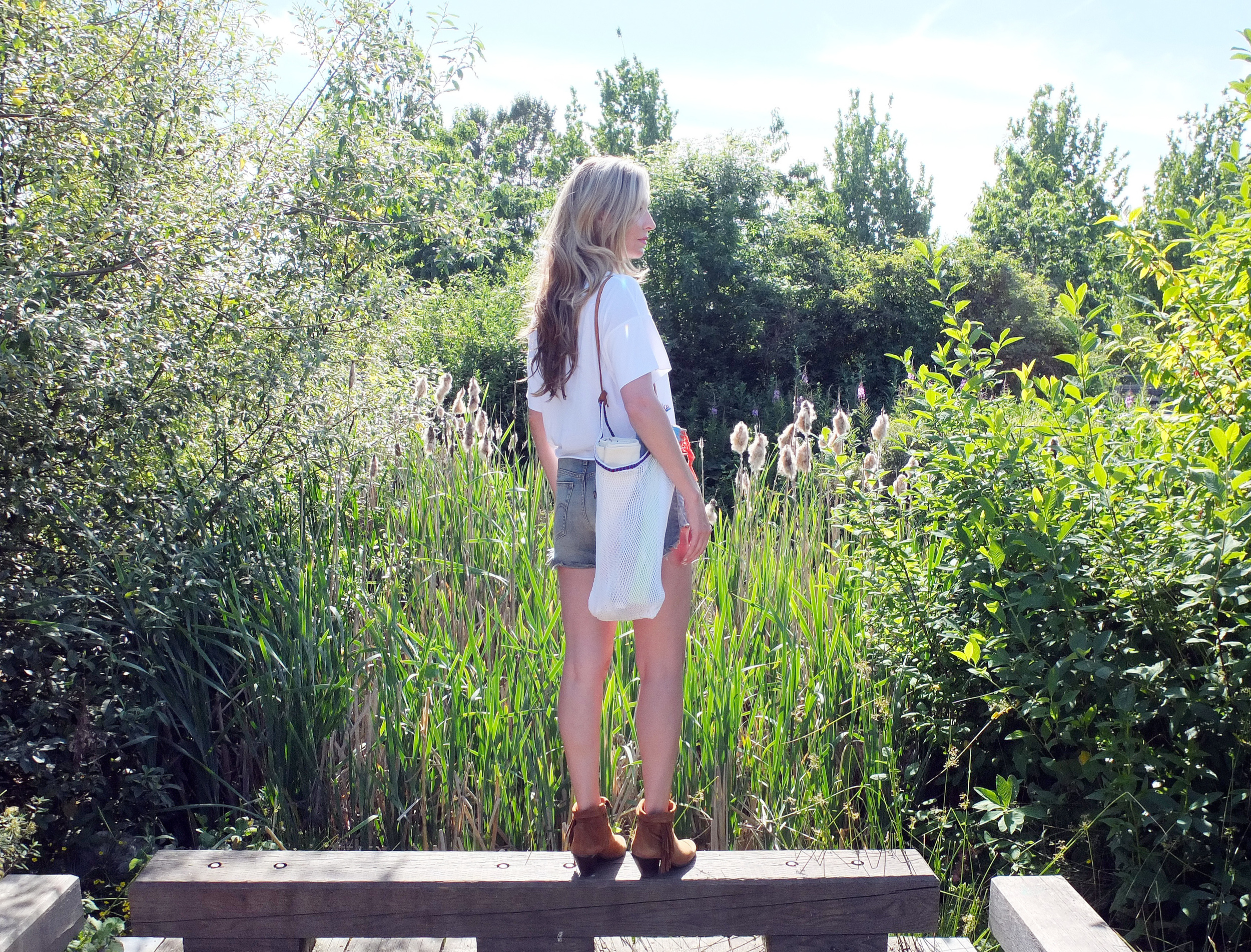 Wearing:  Tulum Beach-Weave Bag in White  // $39