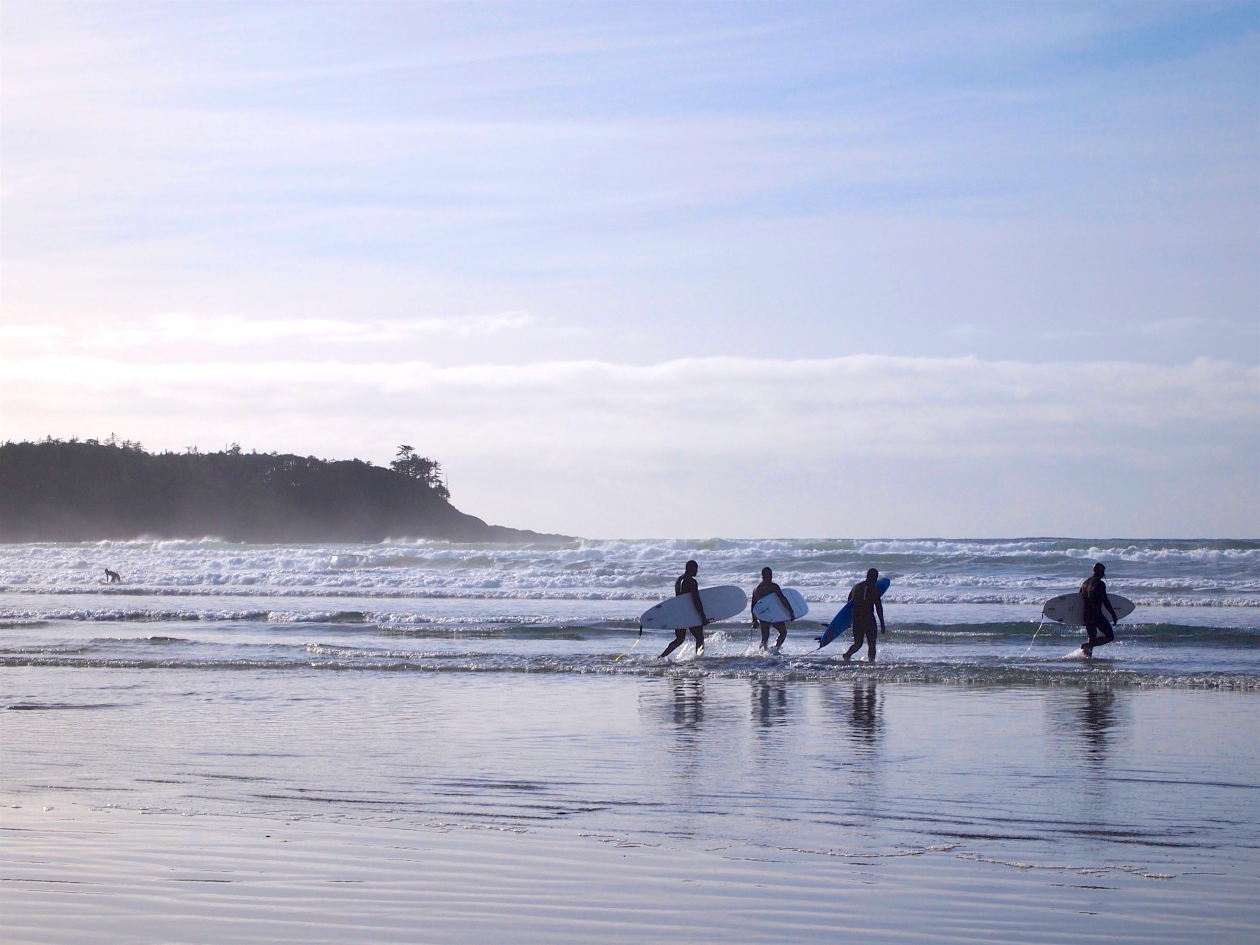 Watching surfers about to brave the waves at Cox Bay in Tofino, BC.
