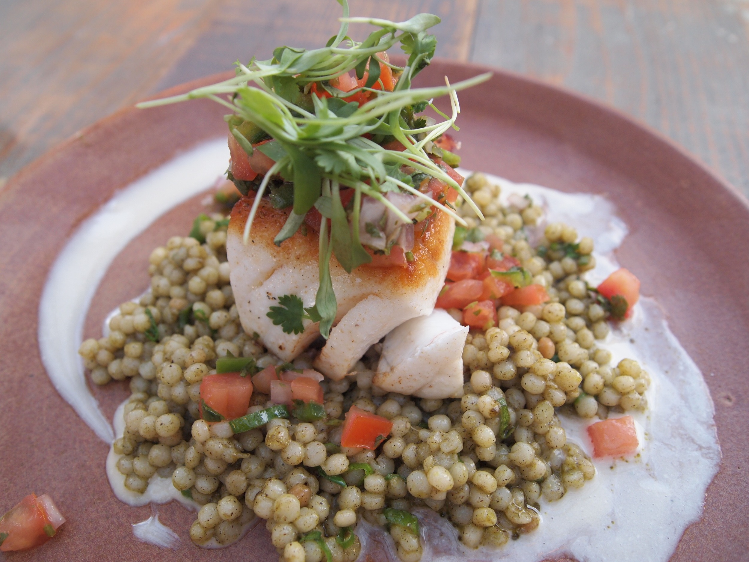 Halibut with Israeli couscous at Outpost, a farm-to-table eatery in The Goodland.