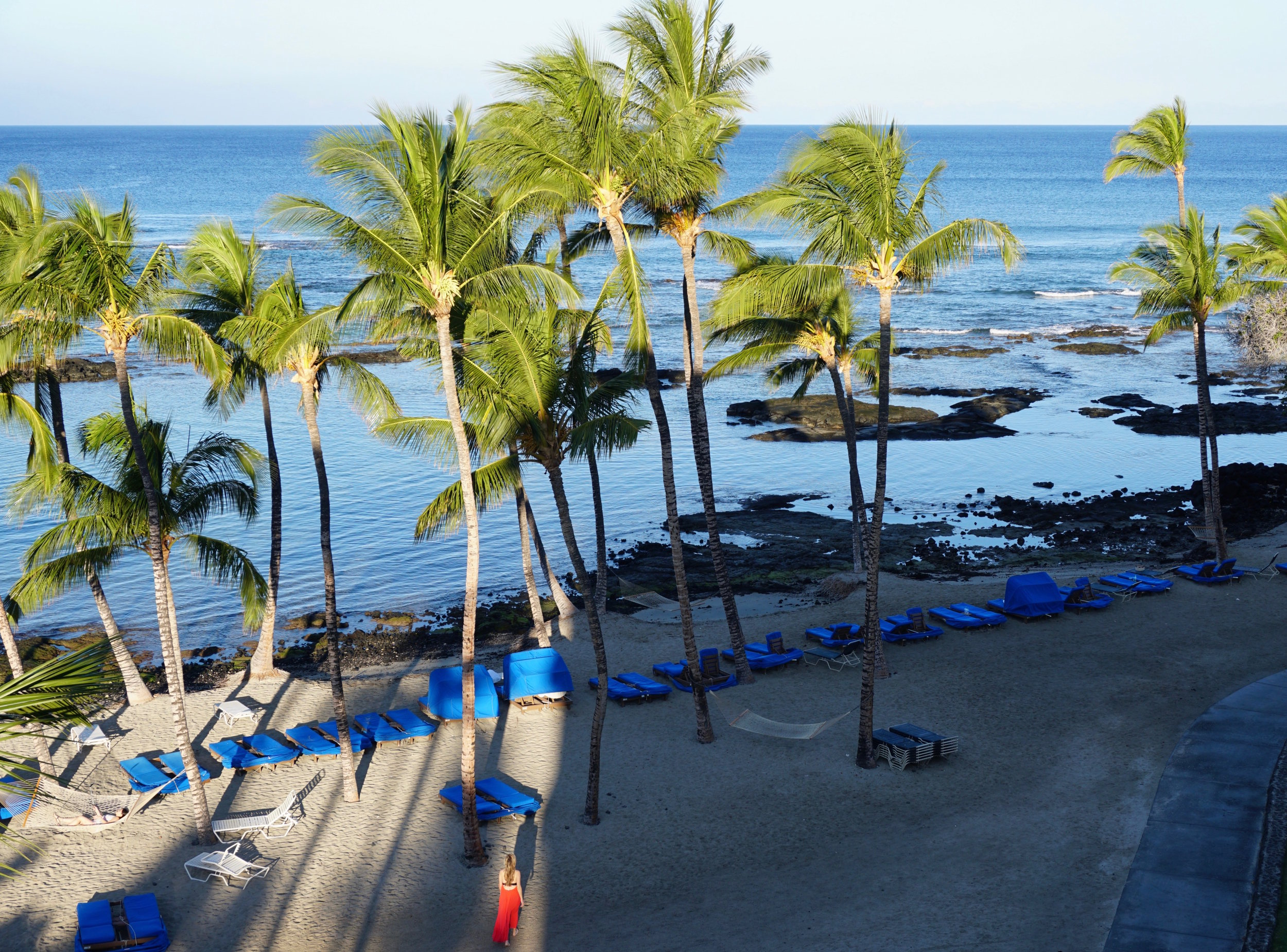 Walking on the beach at  Mauna Lani Bay Hotel & Bungalows , a gorgeous stay edging the sunny Kohala Coast