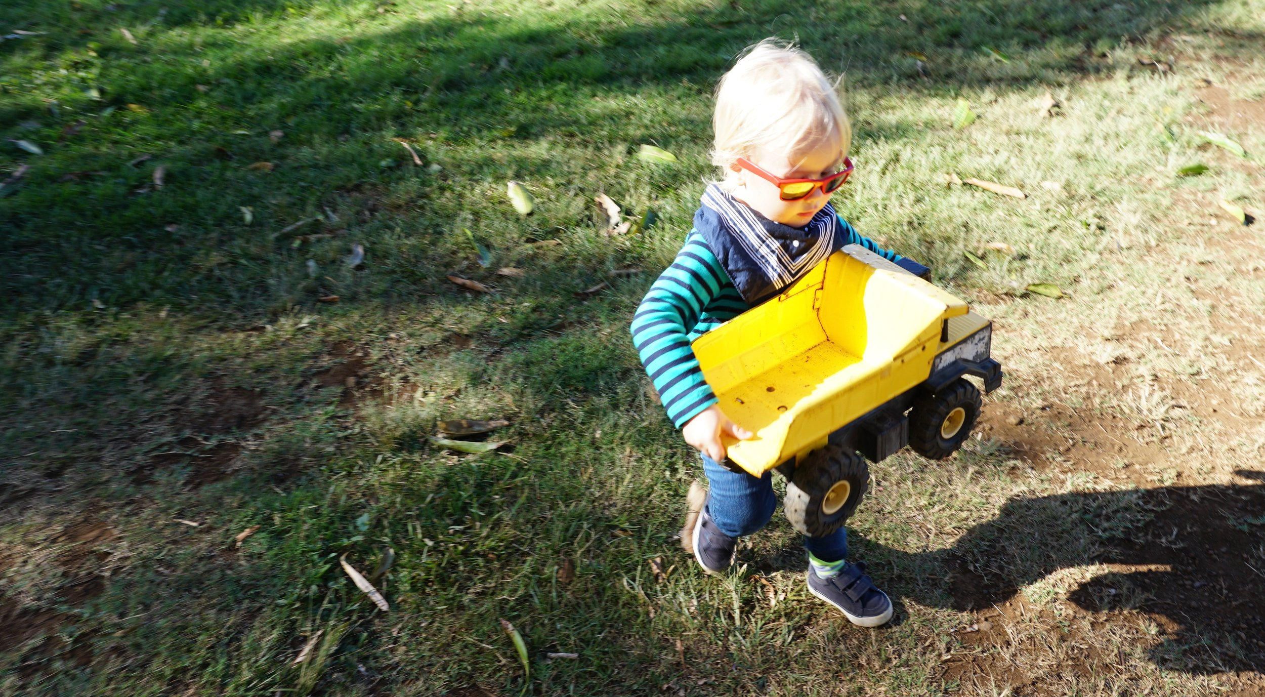 Blue Styler playing with a vintage Tonka dump truck {Mr. Trip Styler used to have one...!} from the Toy Box
