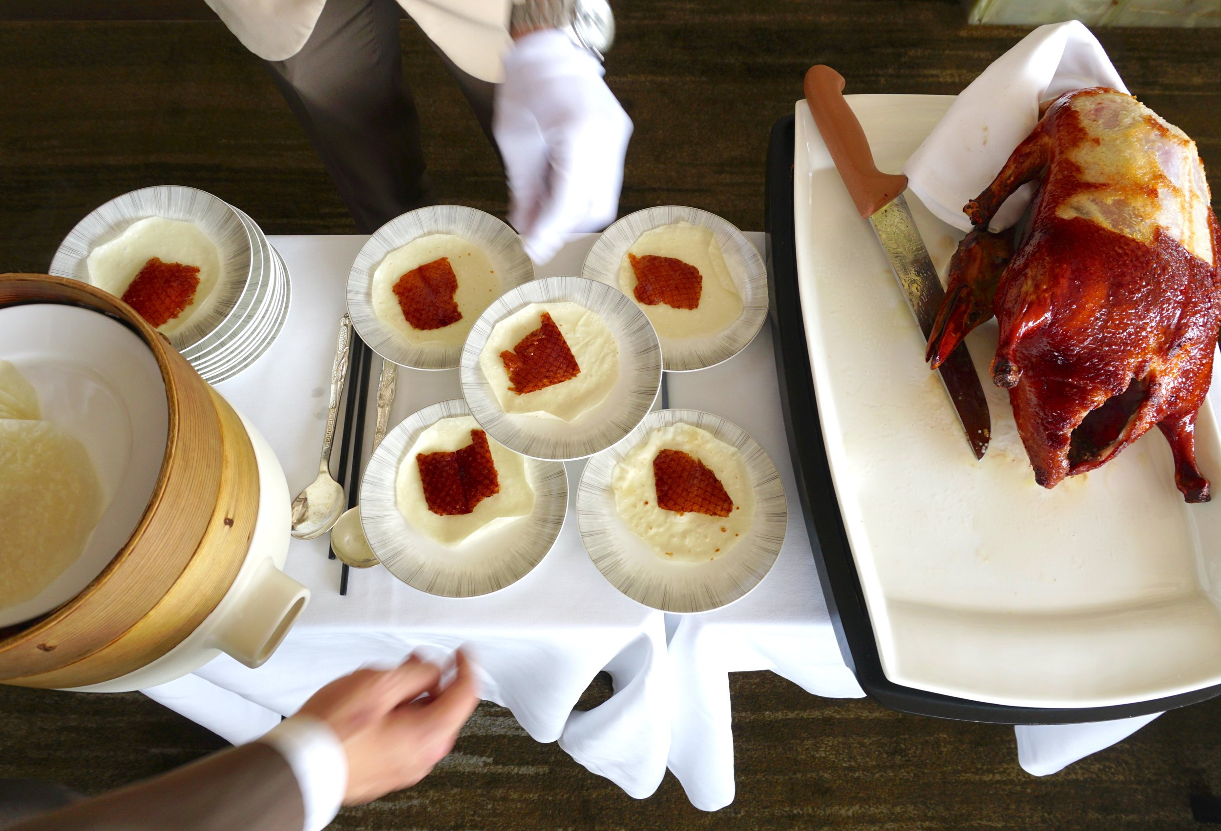 The  pièce de resistance : Peking duck, carved and served on a trolley, tableside.