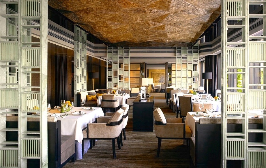 The harbor-view dining room is draped in soft cream linens, mother-of-pearl, and wood accents, which provide a plush backdrop to the main star: The dim sum {historically a snack food for tired and weary travelers}.