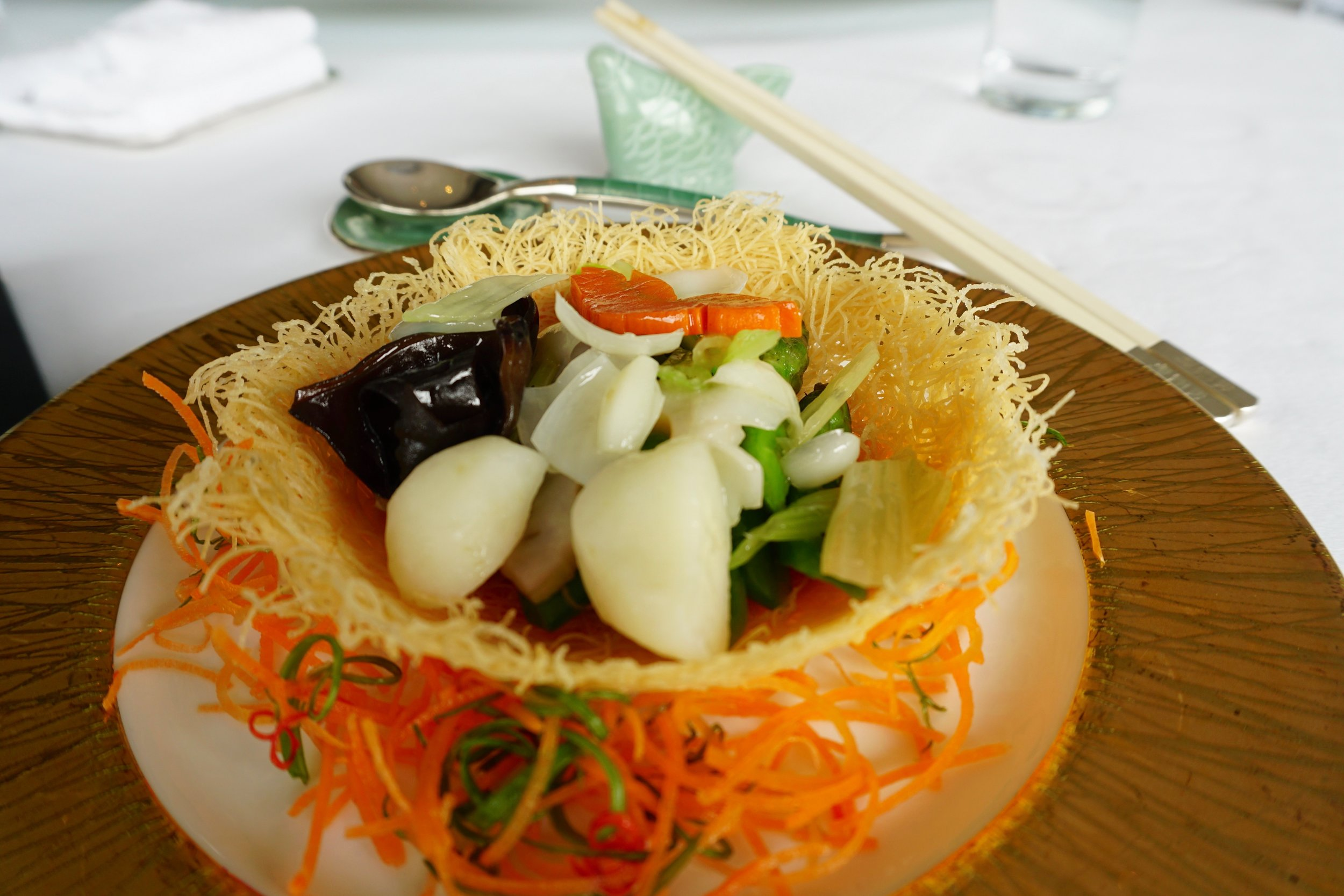 Wok-fried vegetables served in an edible wheat-flour basket.