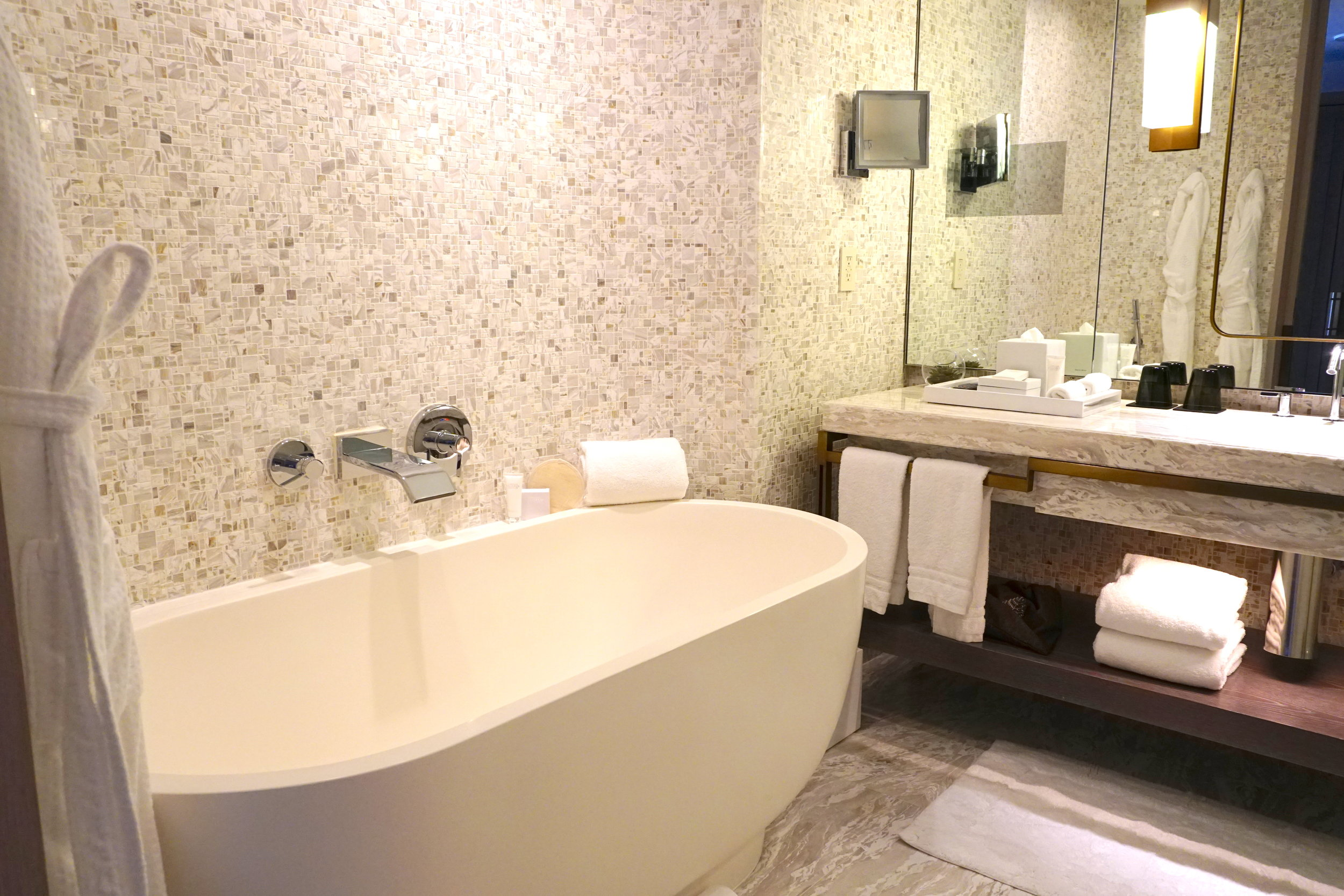 The marble-clad bathrooms at the Four Seasons Hotel New York Downtown