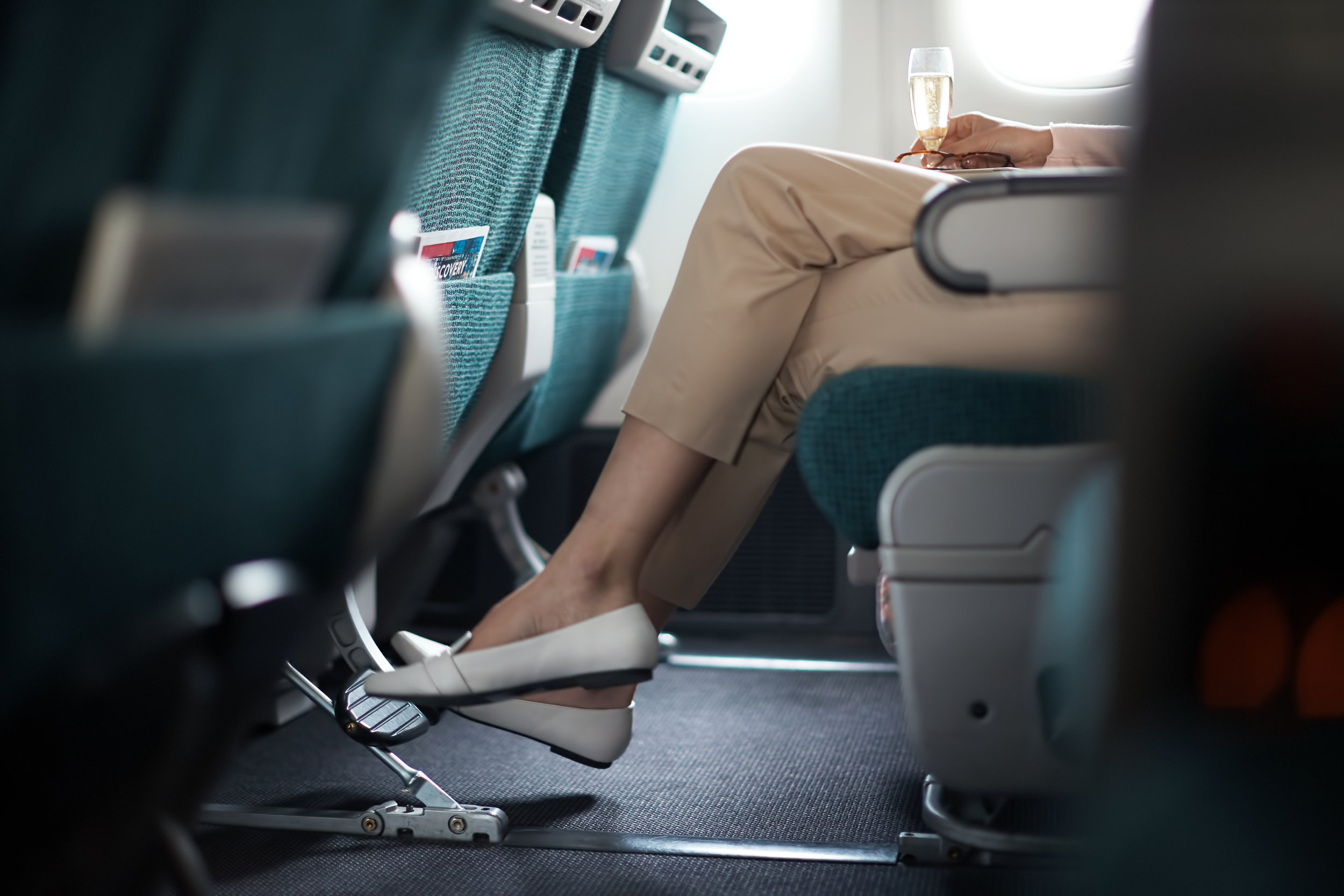 With multiposition headrests for snoozing and ample legroom, even Economy is a well-curated experience aboard Cathay.