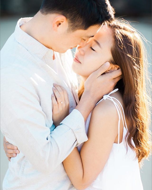 These two rose with the sun to take these images on their couples session with me. It wasn't long until they forgot I was there completely. That's when I was able to take this shot.