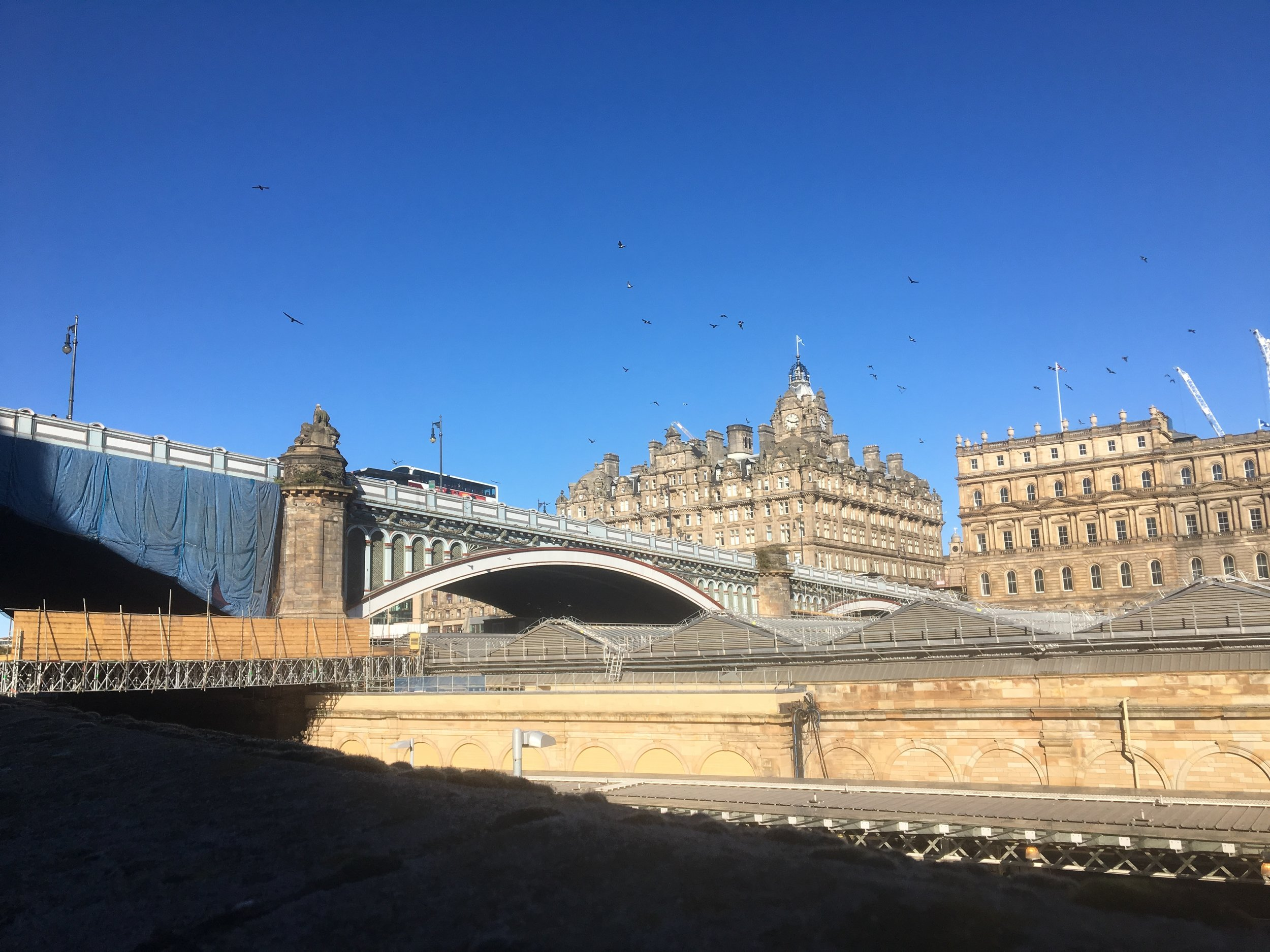 North Bridge connects Old Town and New Town in Edinburgh. The train station runs under the bridge. The buildings in the picture are on the New Town side.