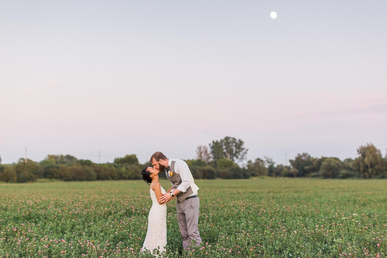 Moonlit Field Couple Kiss