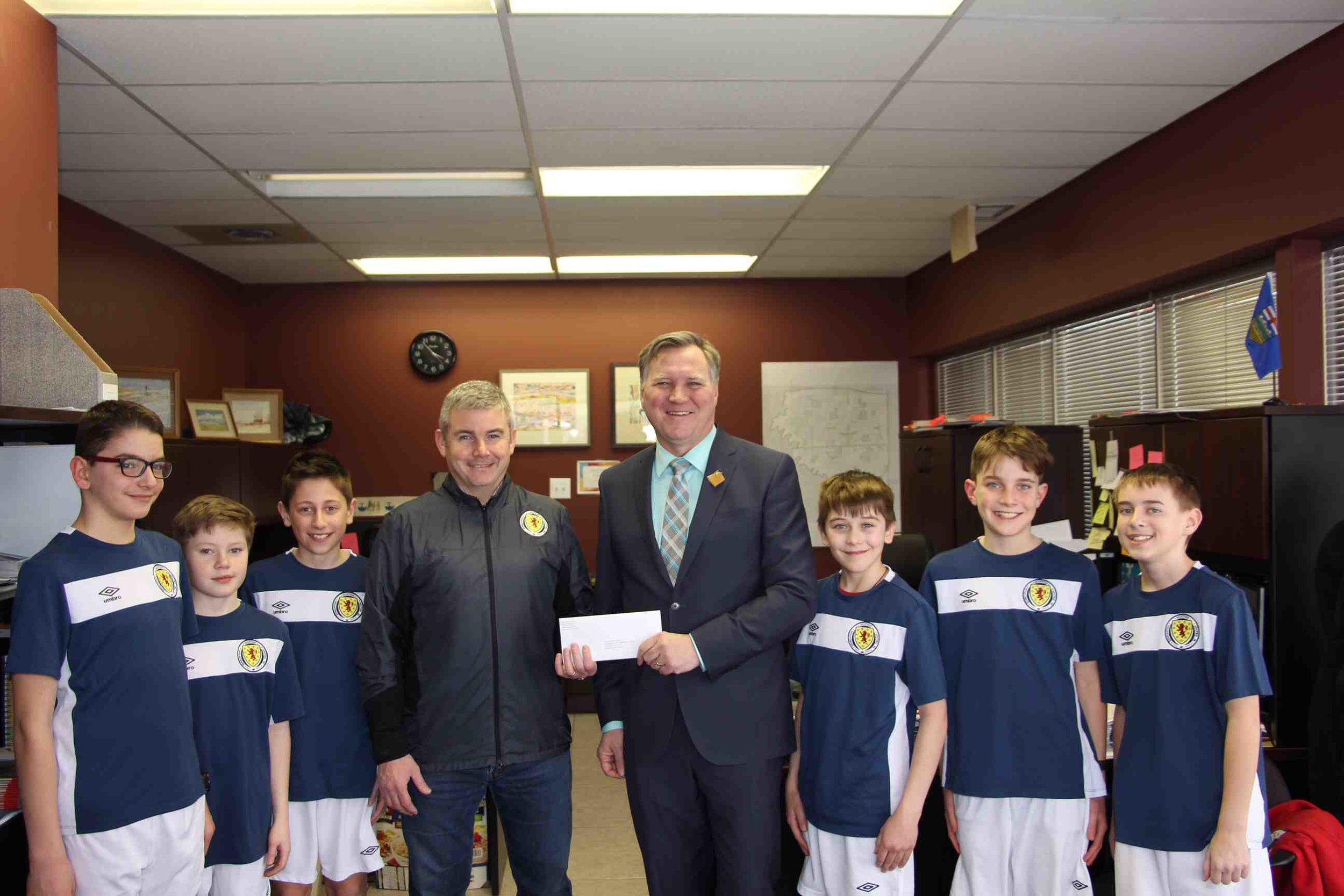 Our U12 Boys and Coach Holt at the Presentation Ceremony with MLA Richard Feehan