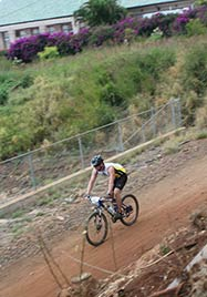 Mountain bike rider on Lanai in WMC bike Jersey