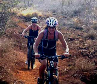 A couple ladies riding West Maui mountain bike trails.