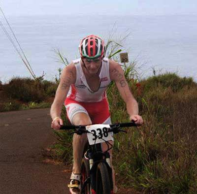 Riding on Team Specialized bikes, Conrad Caveman Stoltz conquers Pole Hill during the TriLanai section of bike racing on Lanai.