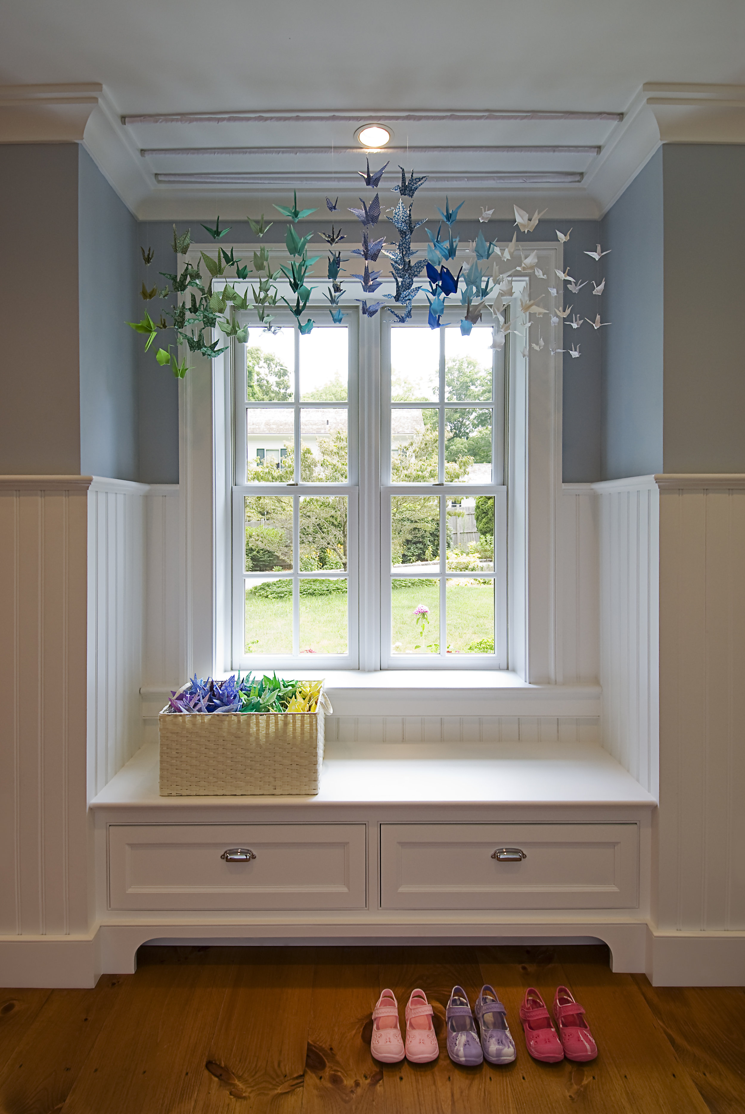 Window seats add comfort and charm to a small hall.