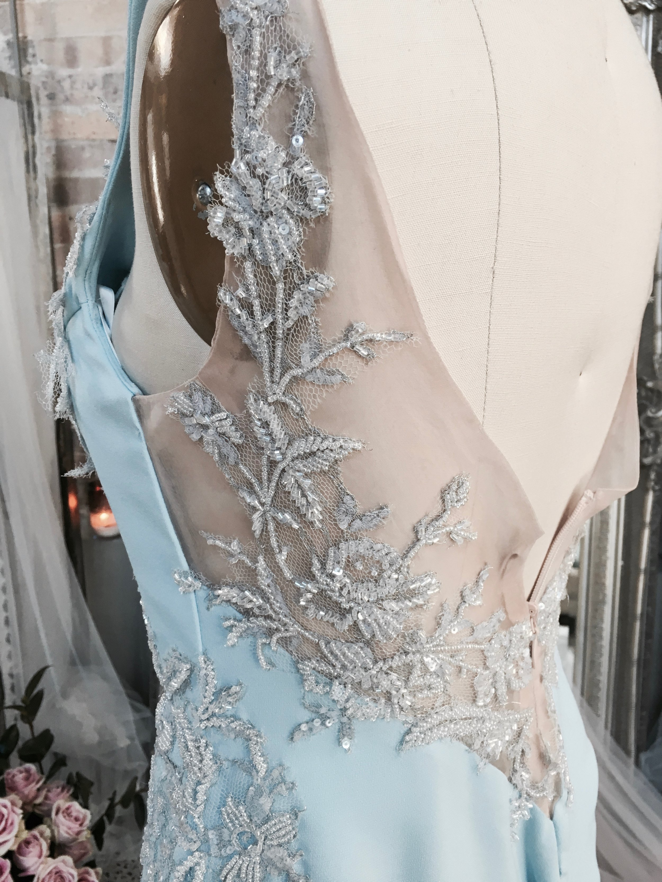 Georgias lace pinned to her gown and ready to be hand stitched