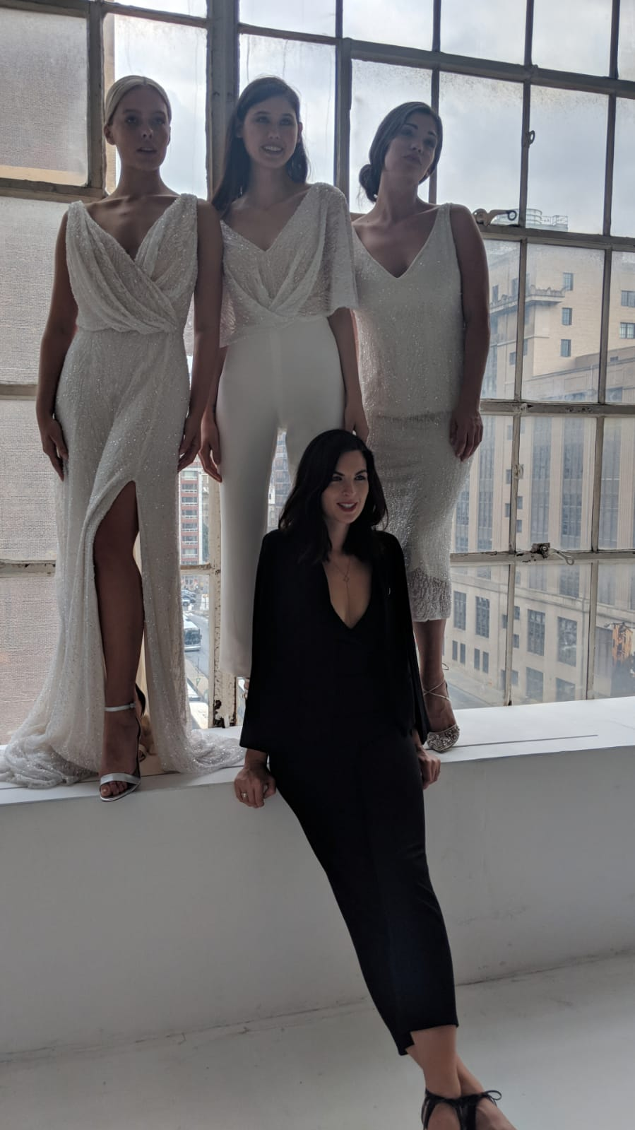 Moira poses with models. Models wear Harriet, Florence and Scarlett gowns - New York Bridal Week