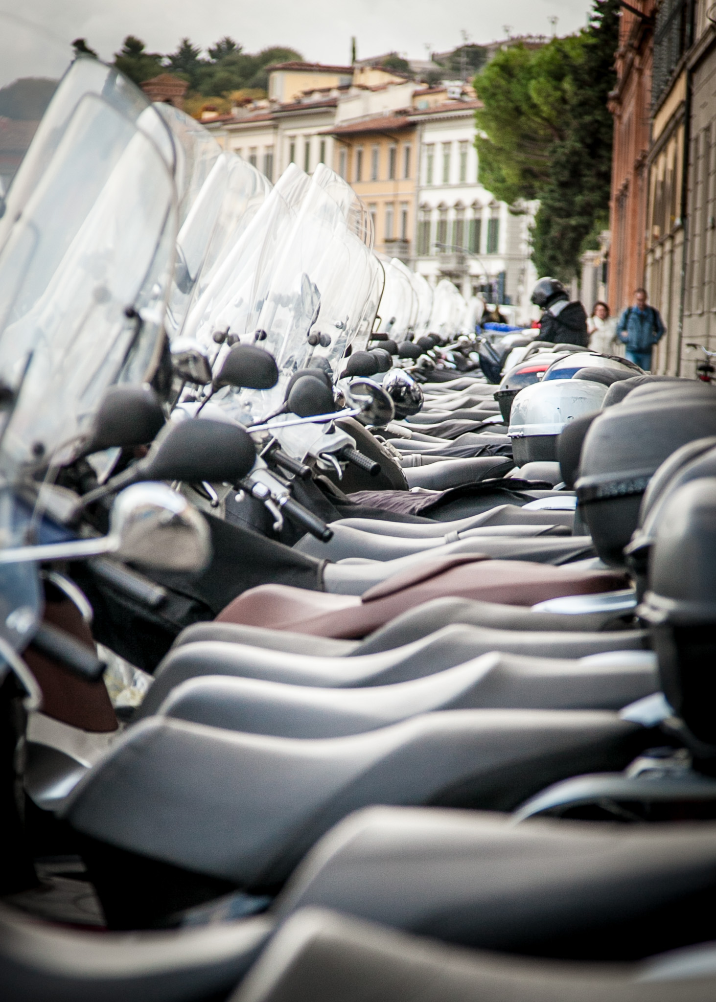 There are millions and millions of motor bikes, scooters and mopeds in Florence.....these are parked next the river Arno