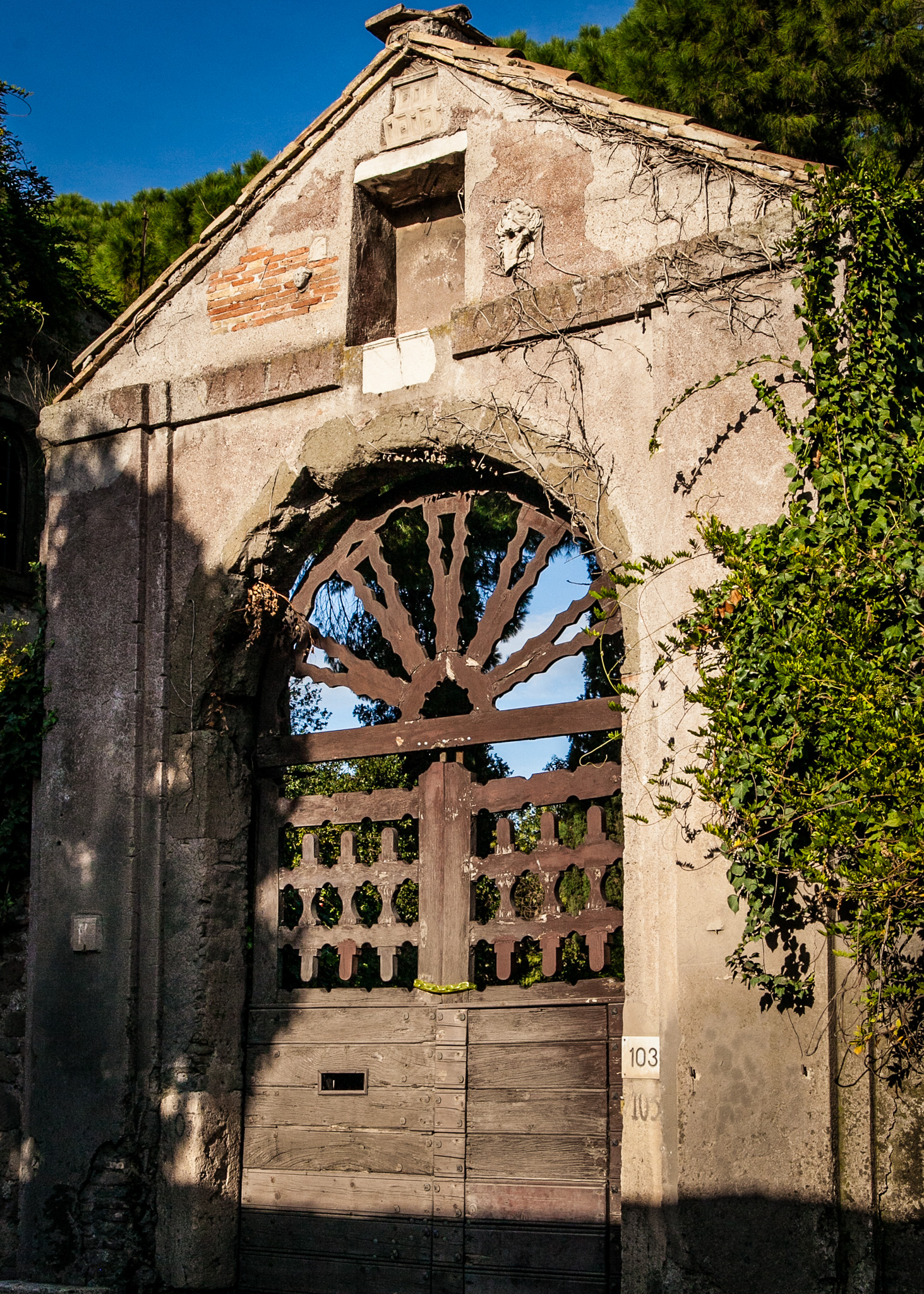 Old rustic gate to some private estate outside Rome