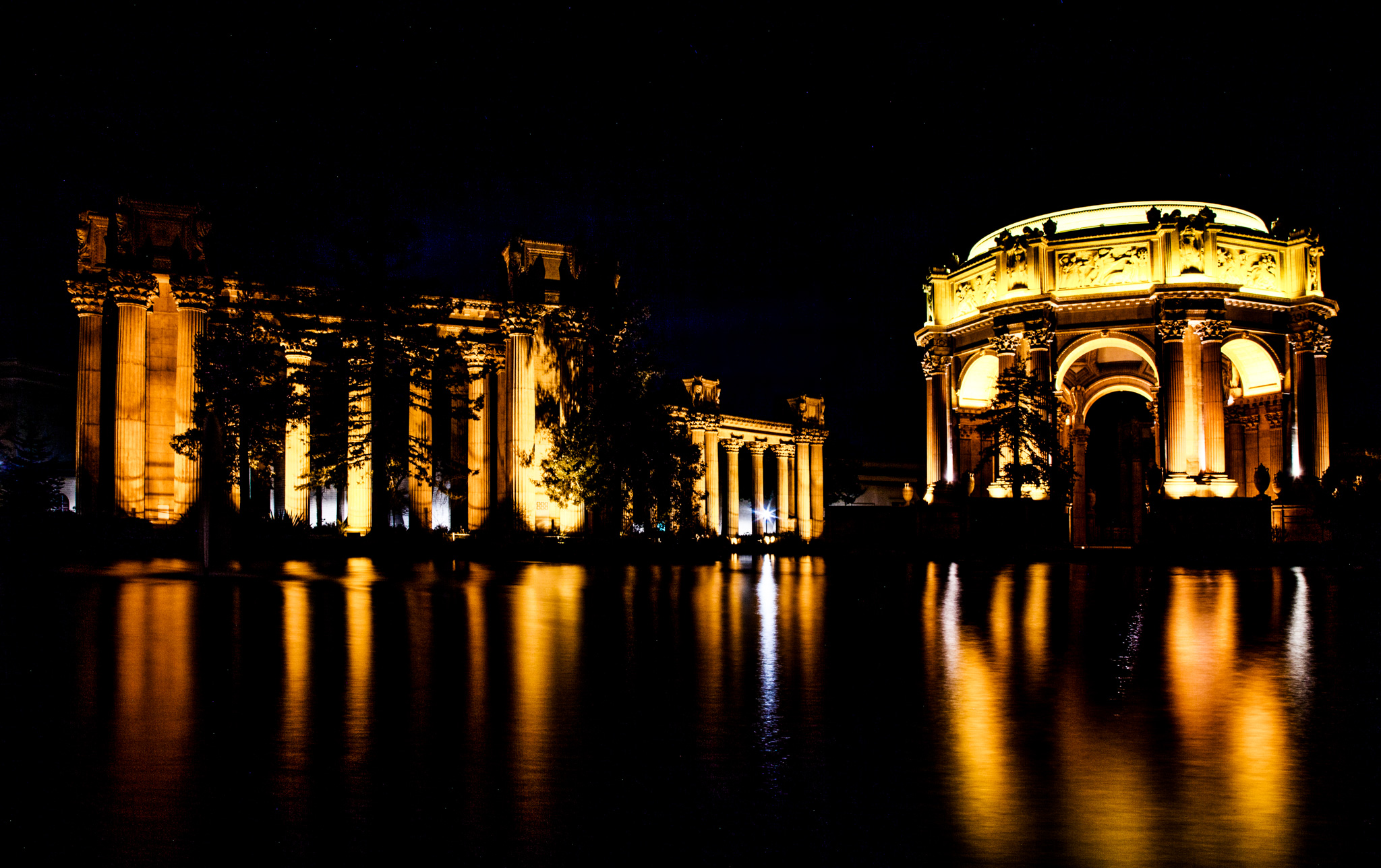 The  Palace of Fine Arts in the  Marina District of  San Francisco, California , is a monumental structure originally constructed for the  1915 Panama-Pacific Exposition in order to exhibit works of art presented there. One of only a few surviving structures from the Exposition, it is still situated on its original site. It was rebuilt in 1965, and renovation of the lagoon, walkways, and a  seismic retrofit were completed in early 2009.  In addition to hosting art exhibitions, it remains a popular attraction for tourists and locals, and is a favorite location for weddings and wedding party photographs for couples throughout the  San Francisco Bay Area , and such an icon that a miniature replica of it was built in  Disney's California Adventure in  Anaheim . [