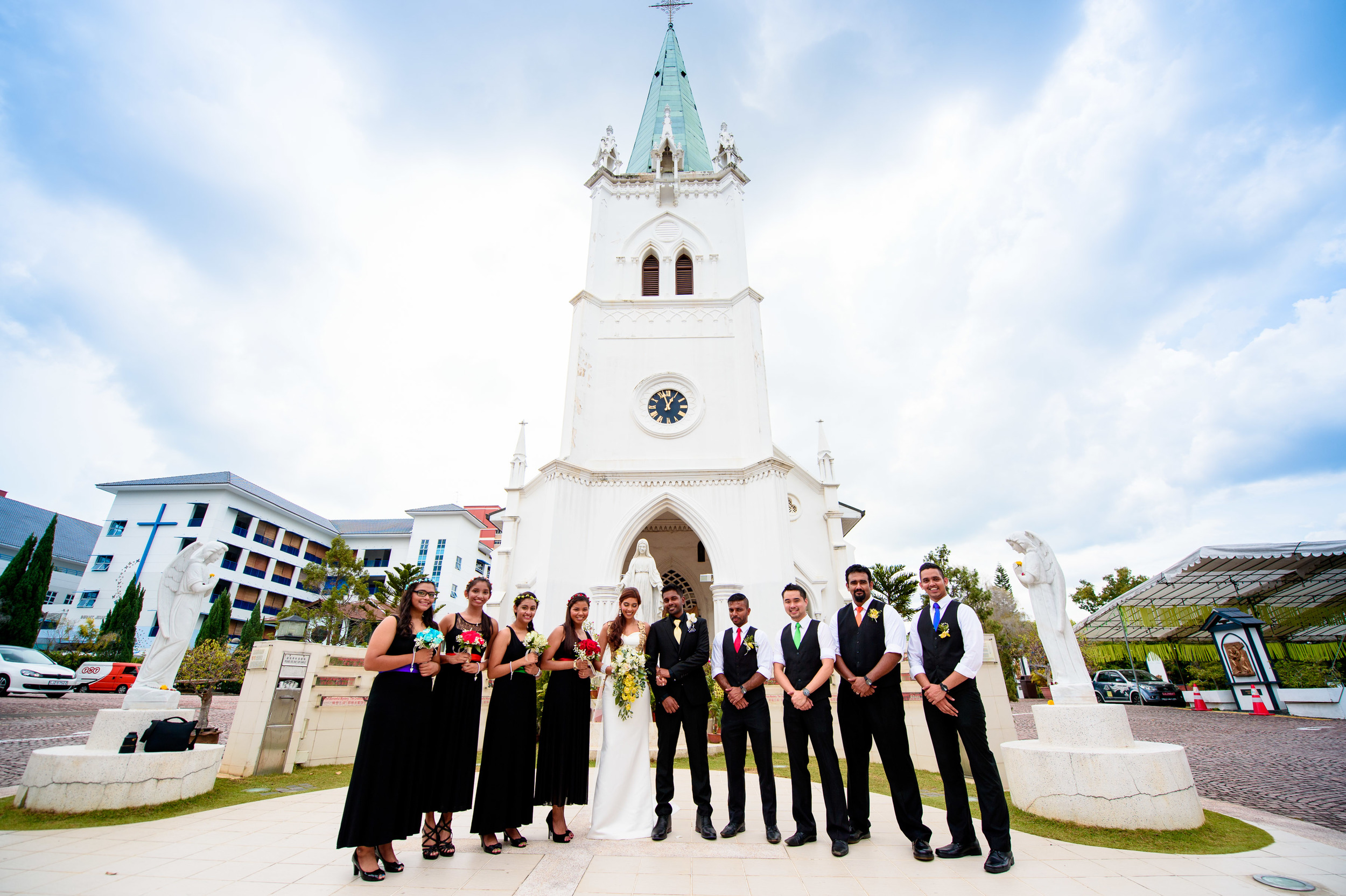 church wedding couple with bestmen & bridesmaids