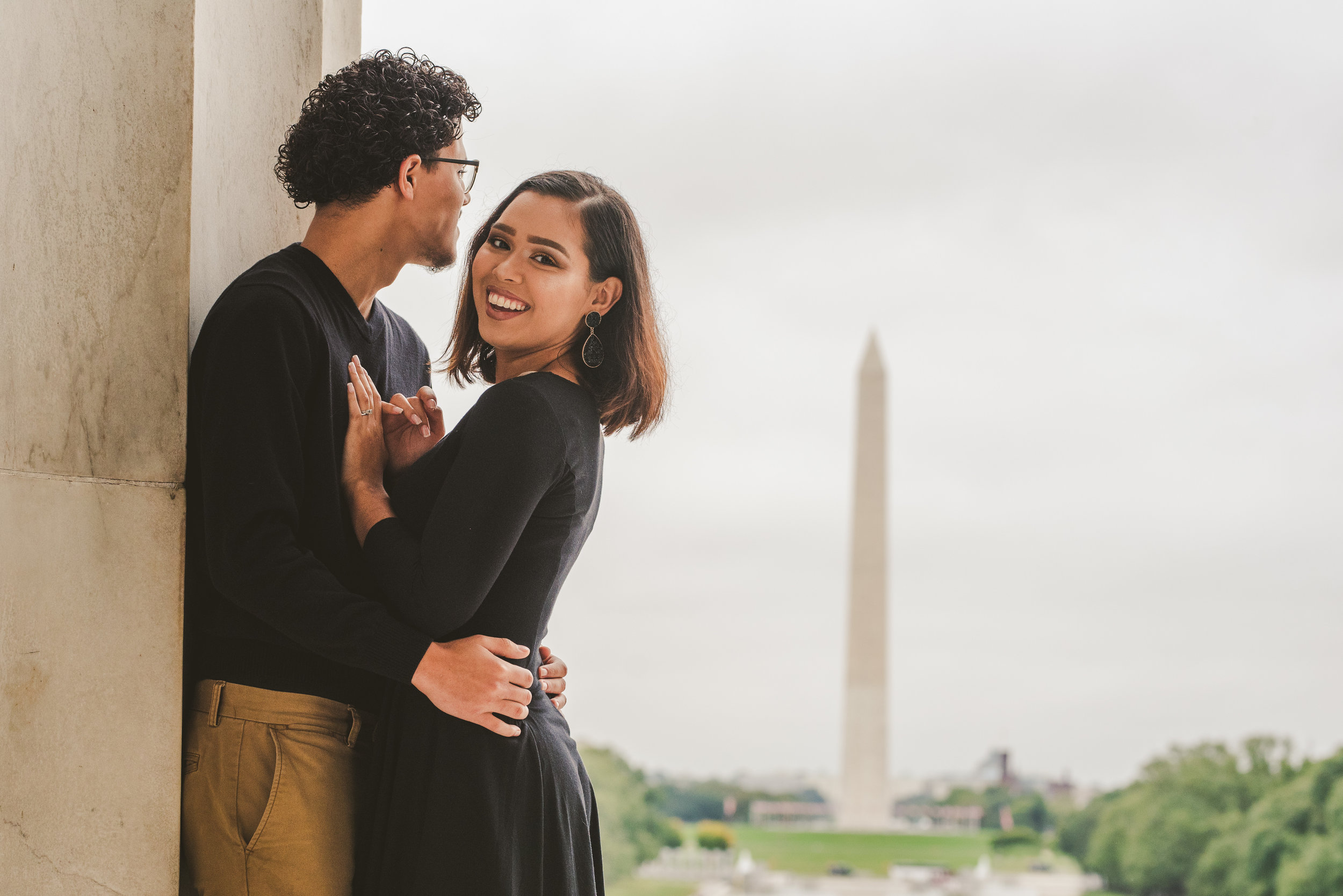 A Couple happy in front of the Washington D.C Monument