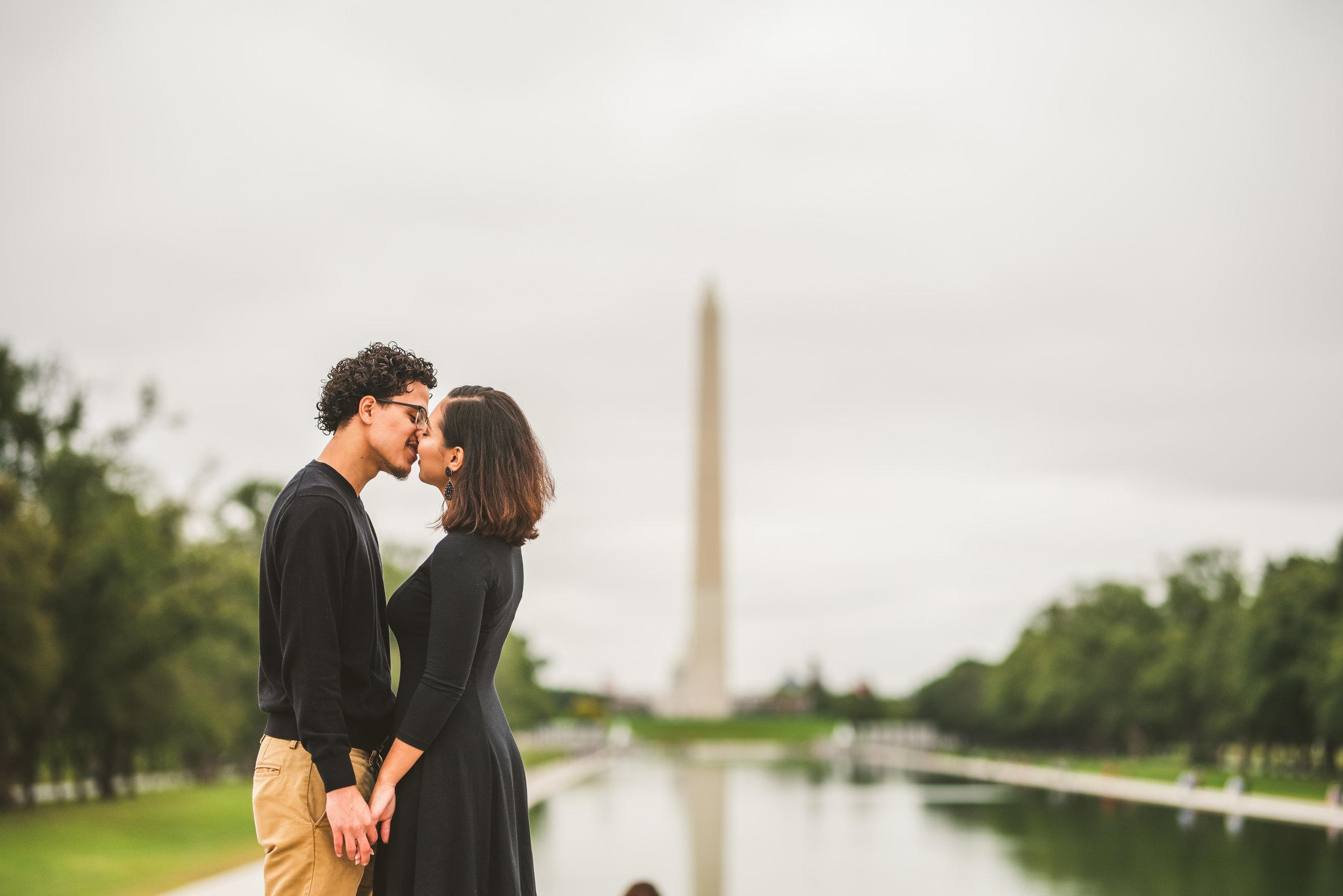 Couple Kissing infront of the Washington Monument in Washington D.C