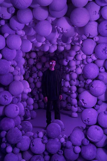 Daniel Arsham (American, born 1980)   Amethyst Sports Ball Cavern , 2016 Amethyst crystal, quartz, and hydrostone Courtesy of Galerie Perrotin/photo by Guillaume Ziccarelli [Daniel Arsham standing at center]