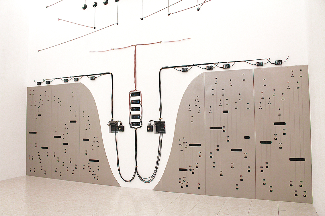 PROPAGATION (OPUS 3), 2015 WOOD, SPEAKERS, AMPLIFIERS, MIXERS, WIRES, CABLES, PIANO STRINGS, BONE, CABLE HOLDERS, CONTACT MICROPHONES, BRASS, SHEET ROCK. 6.5 METERS HIGH X 6.8 METERS WIDE. PHOTO  BY RODRIGO DADA