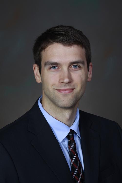 Adam M. Gill