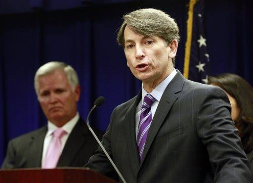 Assistant U.S. Attorney Joseph Johns, right, with Bill Swallow, left, special agent in charge of Dept. of Transportation Office of Inspector General talks during a news conference in Los Angeles, Thursday, March 12, 2015. A Los Angeles County battery recycling plant with a long history of violations of air pollution and hazardous waste laws will close under the agreement with federal prosecutors that requires the company to spend $50 million to clean up the site and surrounding neighborhoods. The deal will result in the immediate and permanent shuttering of the Exide Technologies plant, in Vernon, Calif.    Associated Press