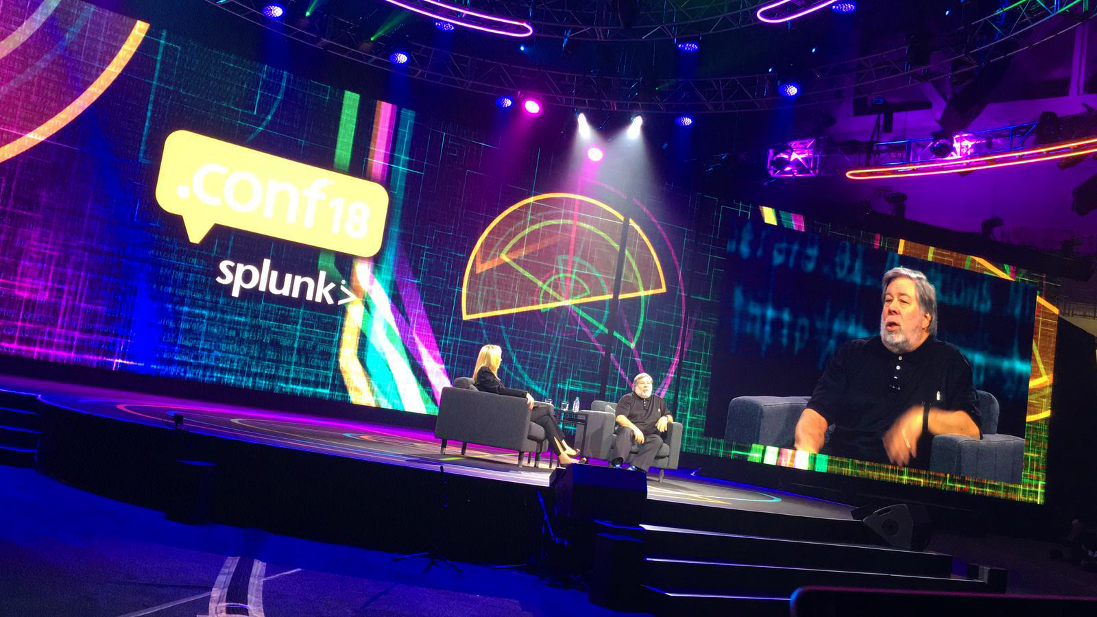 "Steve ""The Woz"" Wozniak  being interviewed with one of  CODesign's  motion graphics for .conf18 in the background. Photo credit:  Splunk Inc."
