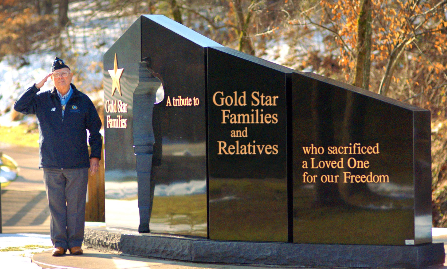 "Hershel ""Woody"" Williams in front of a Gold Star Families Memorial Monument."