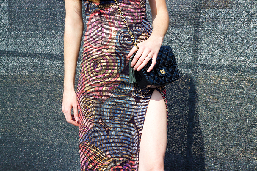 Alex is wearing a VINTAGE 90s multicolor chainmail maxi dress sz.S - $175,  Givenchy  80s quilted leather purse - $195, and  Via Spiga  90s black leather booties Sz.10 - $90
