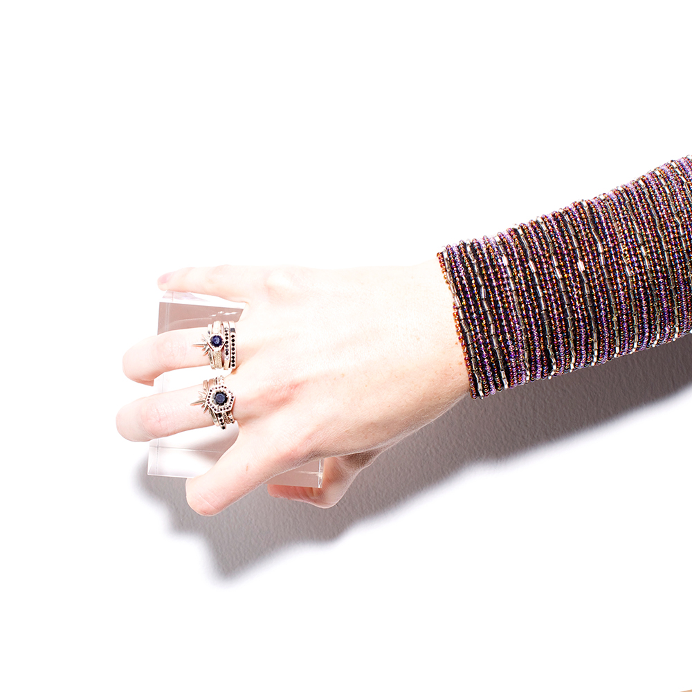 Middle FInger: Studded stack ring $140, Hexagon engagement ring $1720, Fine Geo Gem ring $240, Starburst Band RIng $160. RIng Finger: Two stacked Fine Geo Gem rings $240 each, Snakebite ring with sapphire $220, Starburst Band ring $160  Multiple sizes available please call to purchase! 512-462-4667